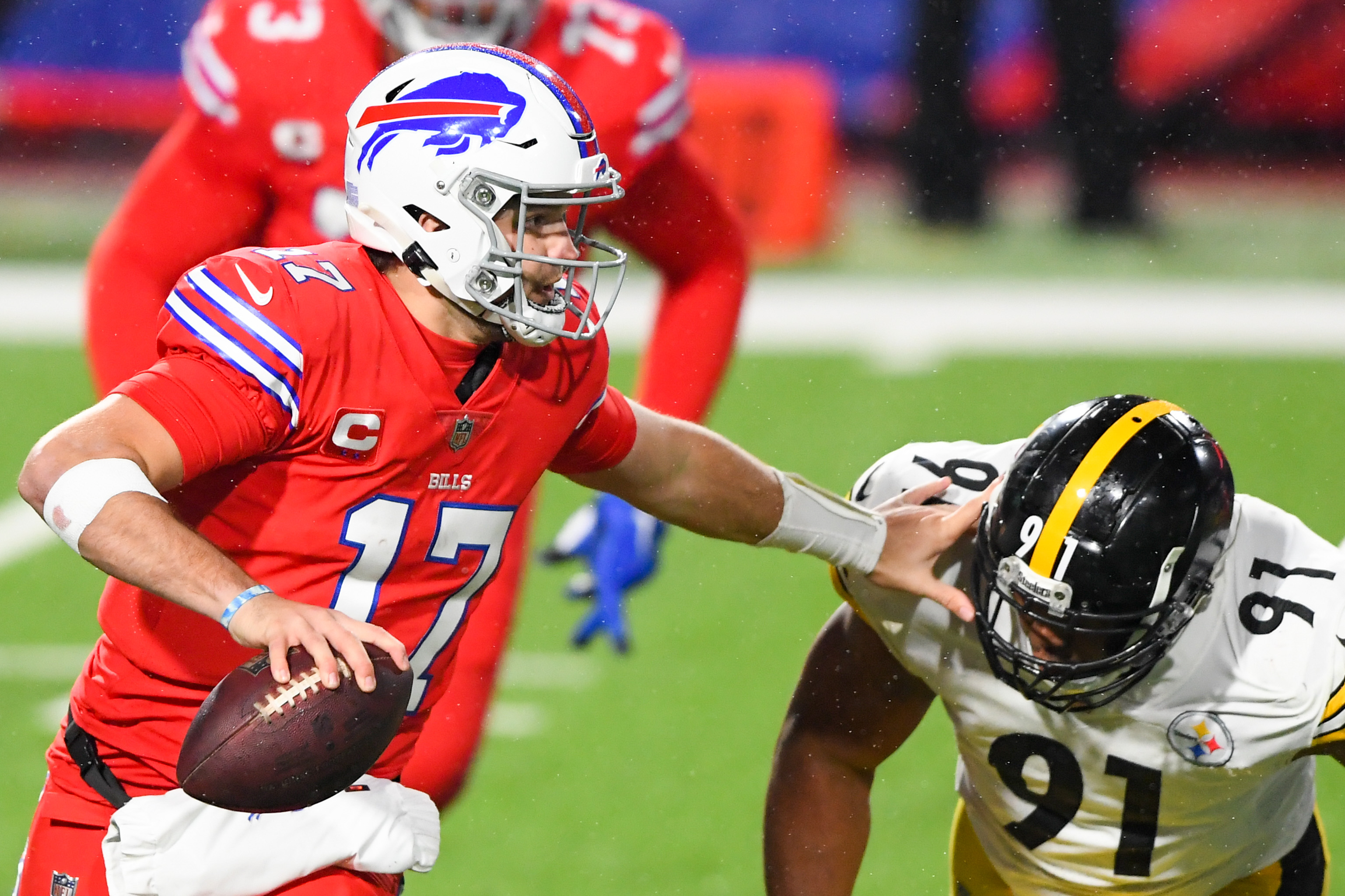 Buffalo Bills quarterback Josh Allen (17) avoids Pittsburgh Steelers defensive end Stephon Tuitt (91) while running with the ball during the second quarter at Bills Stadium.
