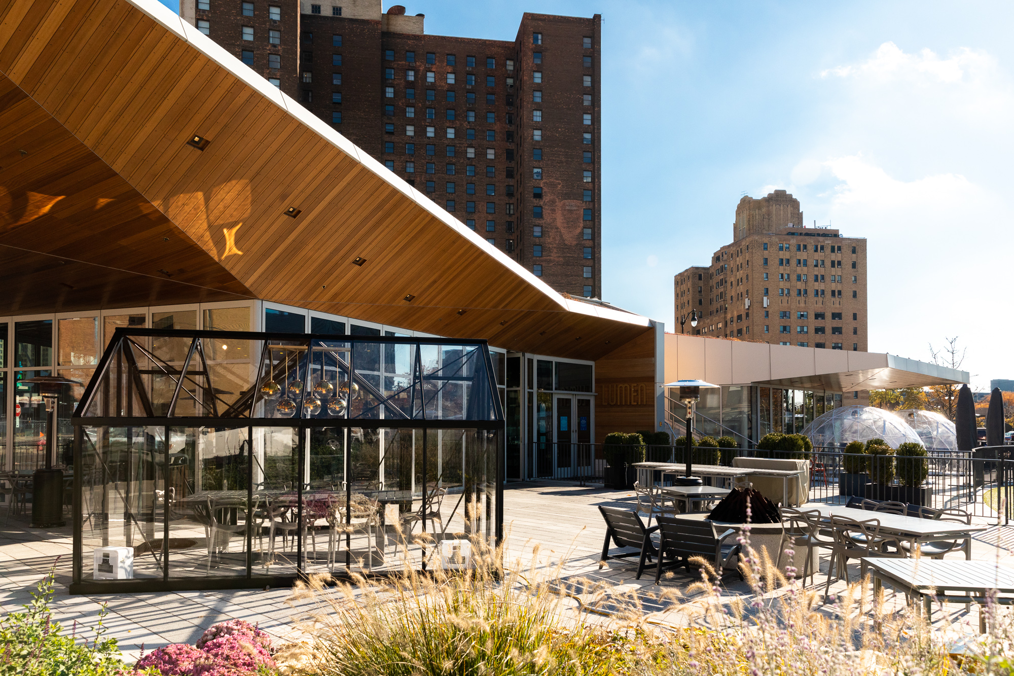 Geodesic domes and glass dining enclosures stand outside of Lumen in Detroit on a sunny fall day.
