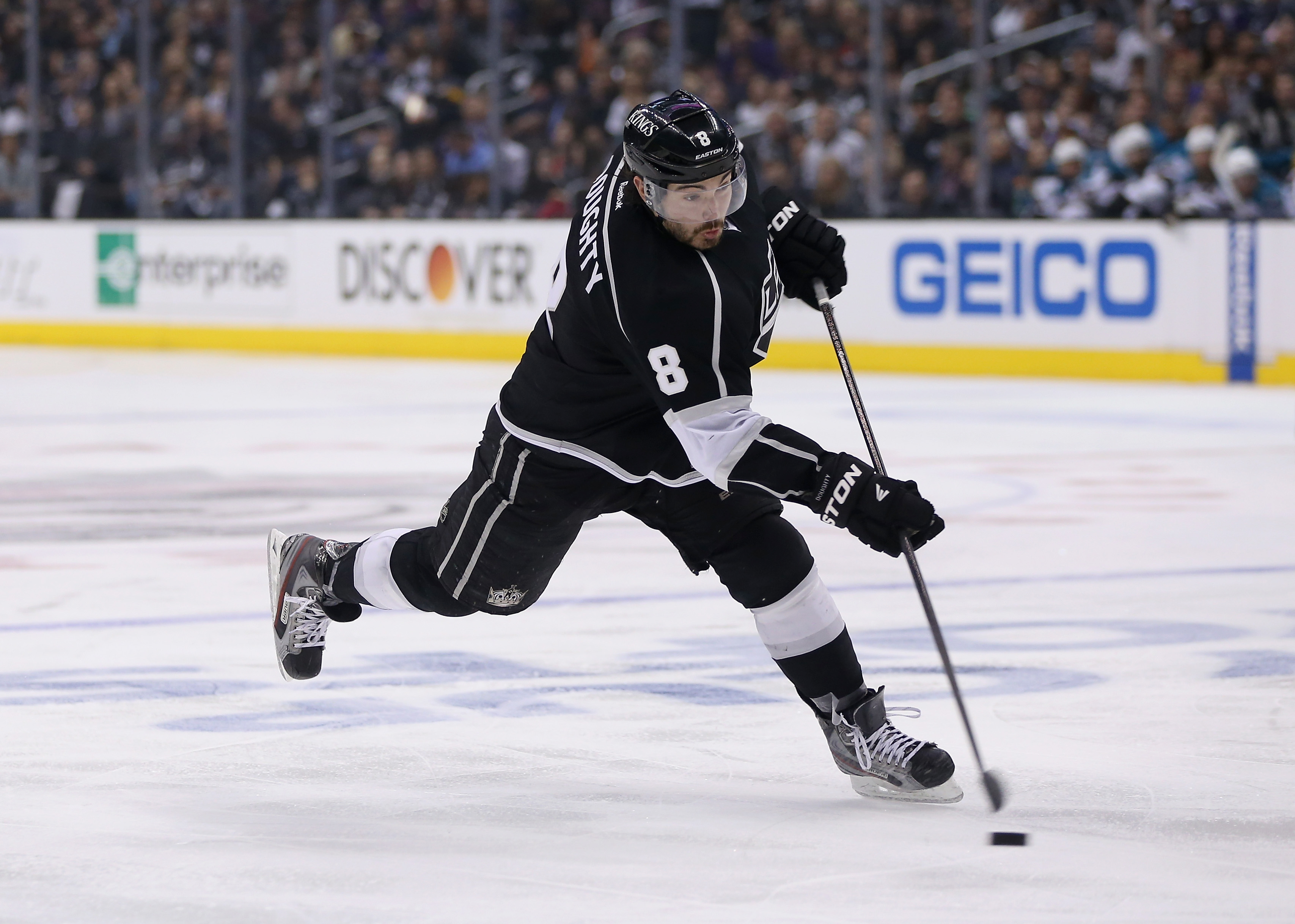 Drew Doughty of the Los Angeles Kings shoots and scores a goal against the San Jose Sharks in the second period of Game Two of the Western Conference Semifinals during the 2013 NHL Stanley Cup Playoffs at Staples Center on May 16, 2013 in Los Angeles, California. The Kings defeated the Sharks 4-3.