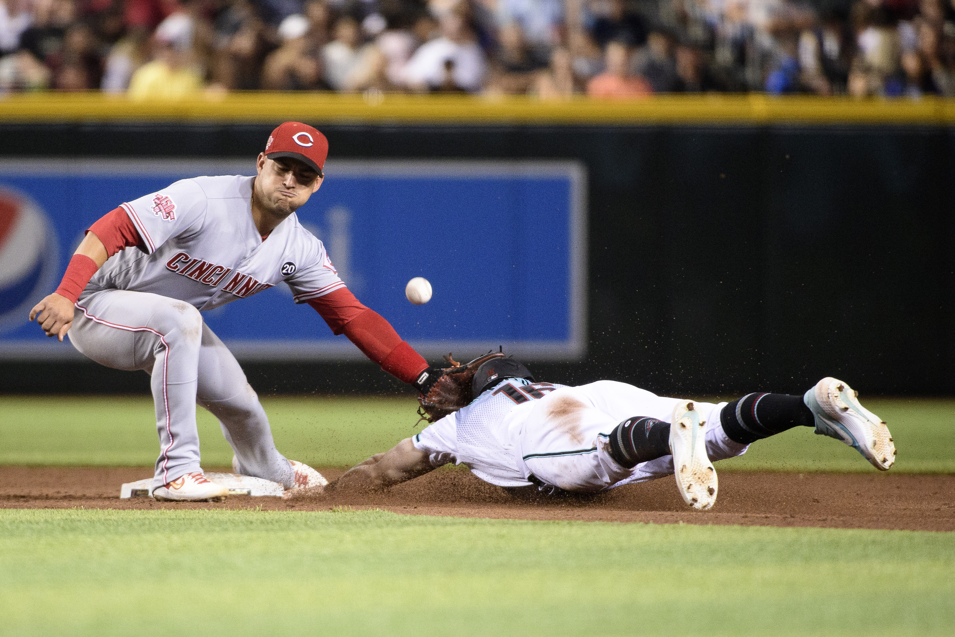 Tim Locastro safely steals second base.