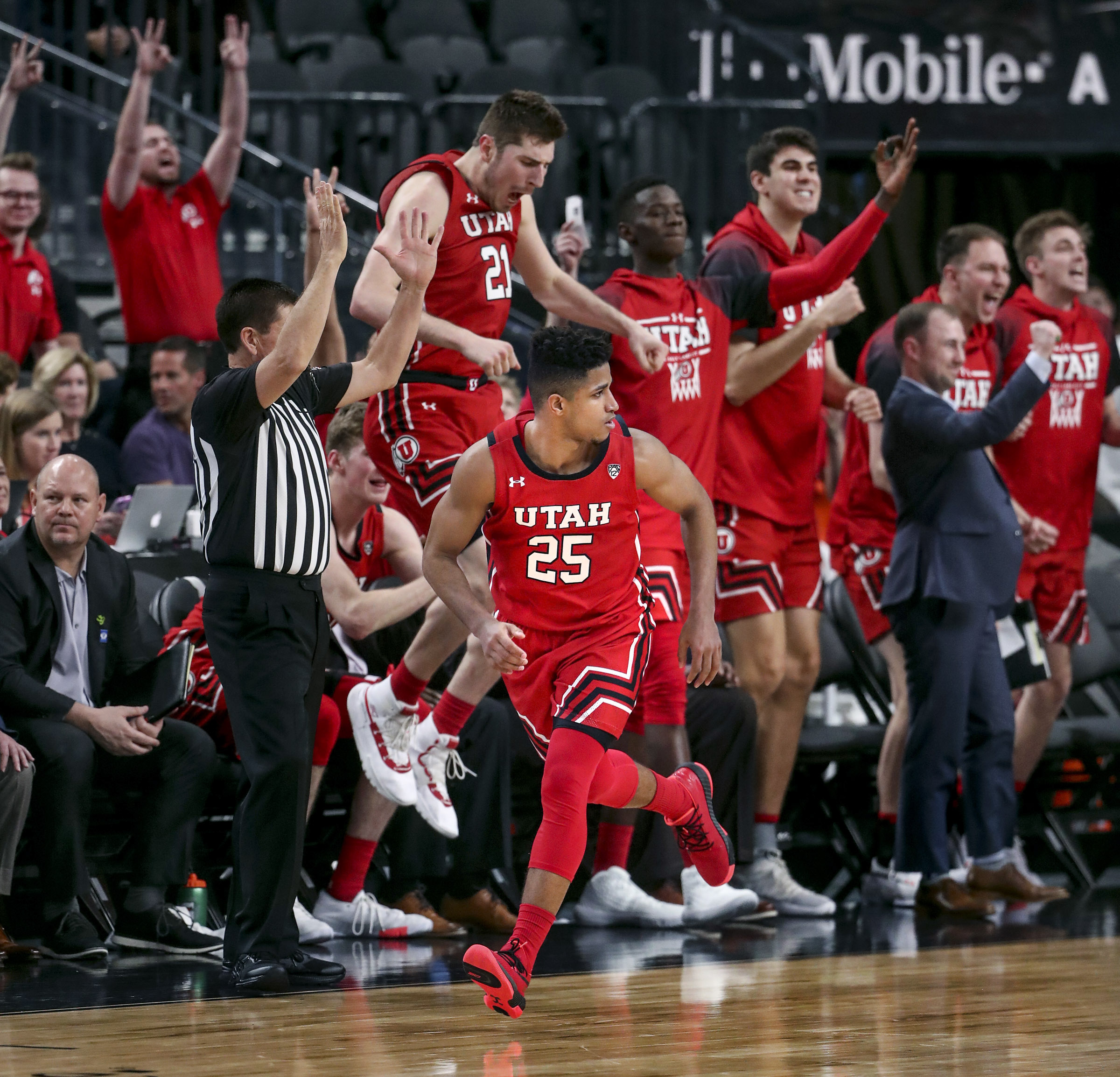 Utah Utes guard Alfonso Plummer (25), center, runs back up the court as the Utah bench celebrates Plummer's eleventh 3-pointer during their game against the Oregon State Beavers during the first round of the Pac-12 men's basketball tournament at T-Mobile Arena in Las Vegas on Wednesday, March 11, 2020.