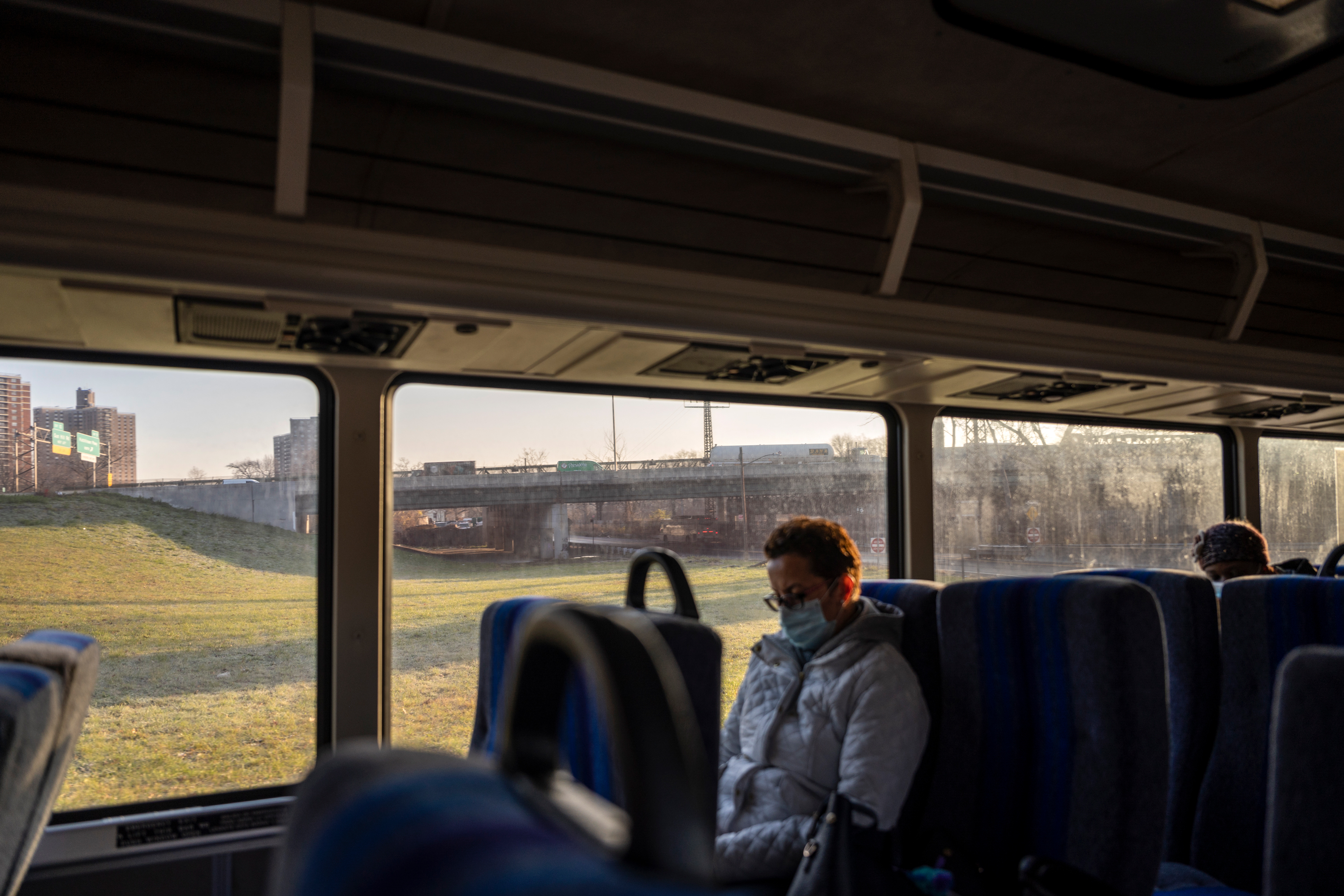 Commuters take a near-empty BxM7 express bus from The Bronx to Midtown, Manhattan, Dec. 11, 2020.
