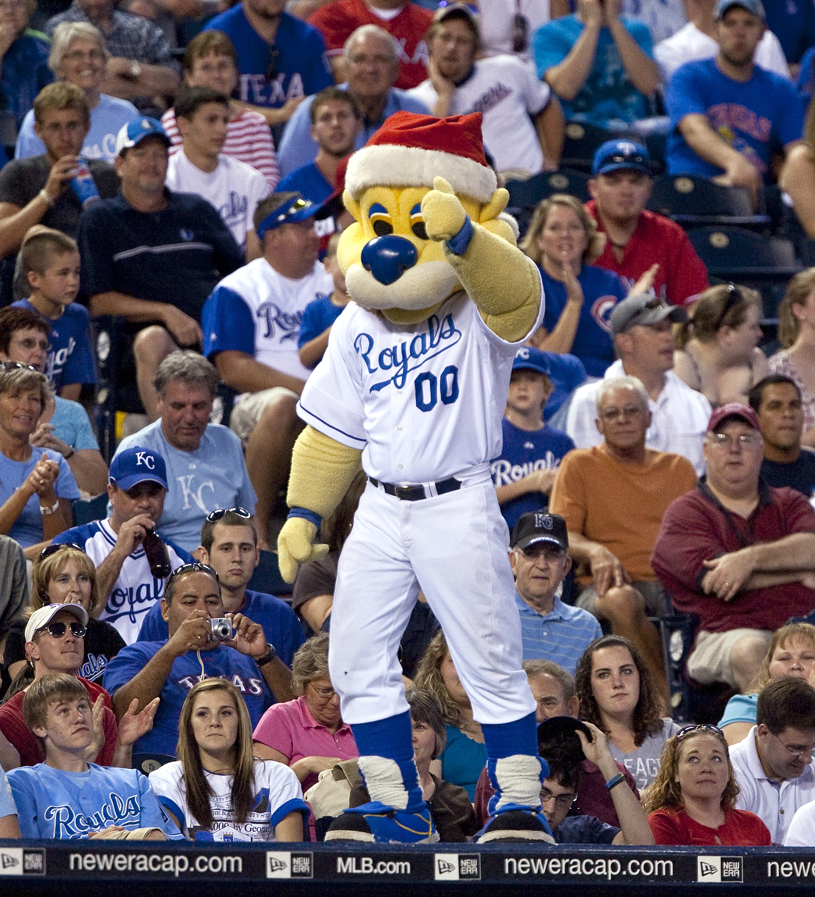 In honor of Christmas in July, Kansas City Royals mascot Sluggerrr wore a Santa hat as he cheared on the Royals during the ninth inning against the Texas Rangers. The Royals defeated the Rangers, 6-3, at Kauffman Stadium in Kansas City, Missouri, Saturday, July 25, 2009.