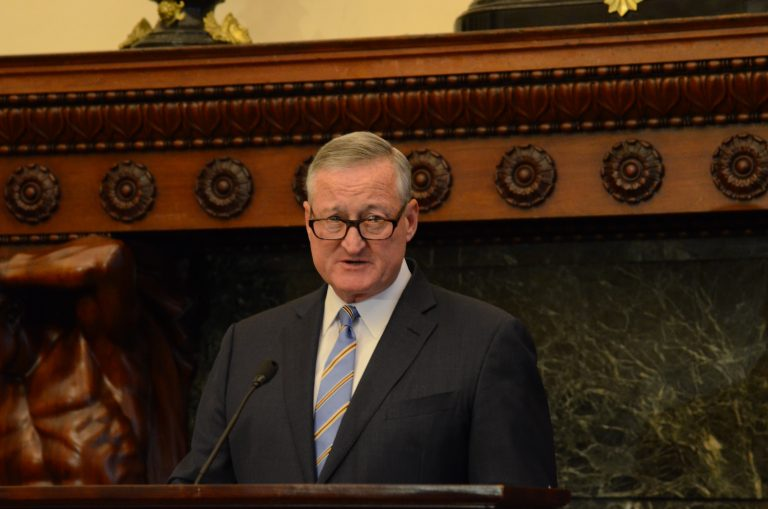 Philadelphia Mayor Jim Kenney making an announcement at a podium.