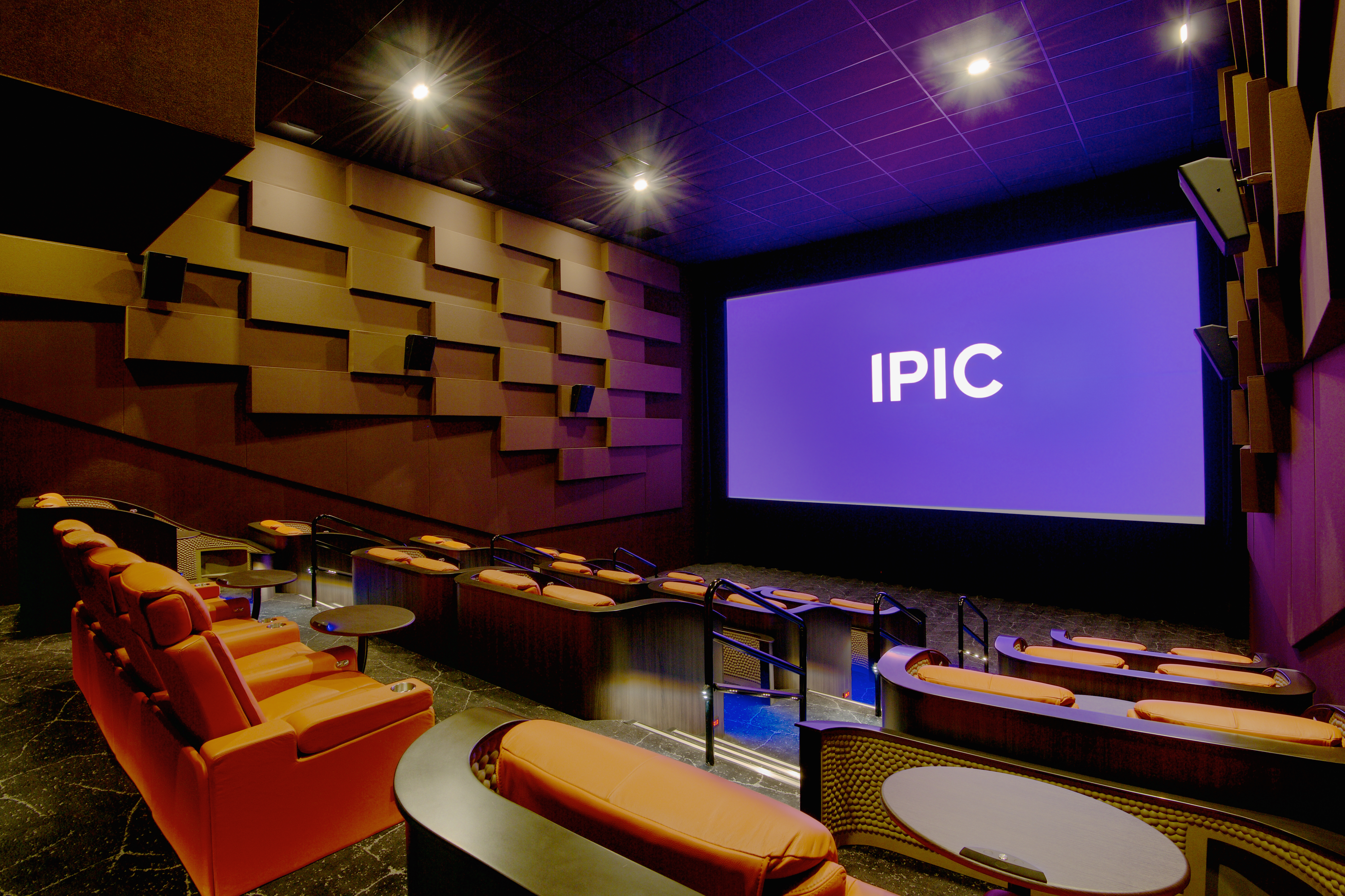 A small theatre at iPic in Atlanta with table seating and pod seating