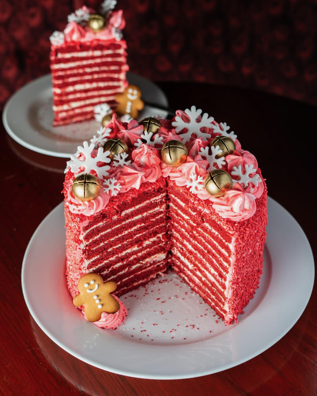 A 20-layer red velvet cake with snowflakes and bells on top