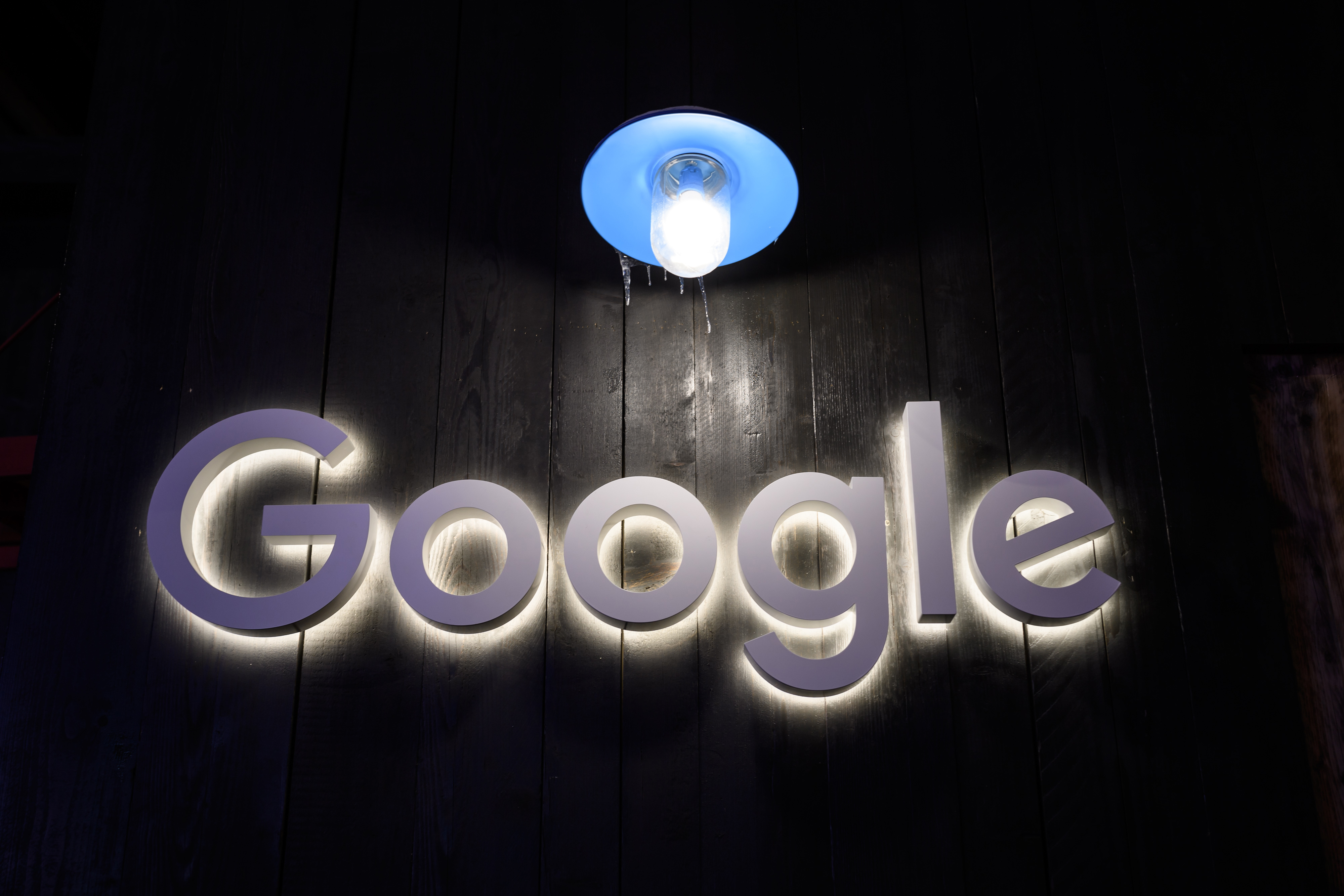 Google logo with a spotlight over it.