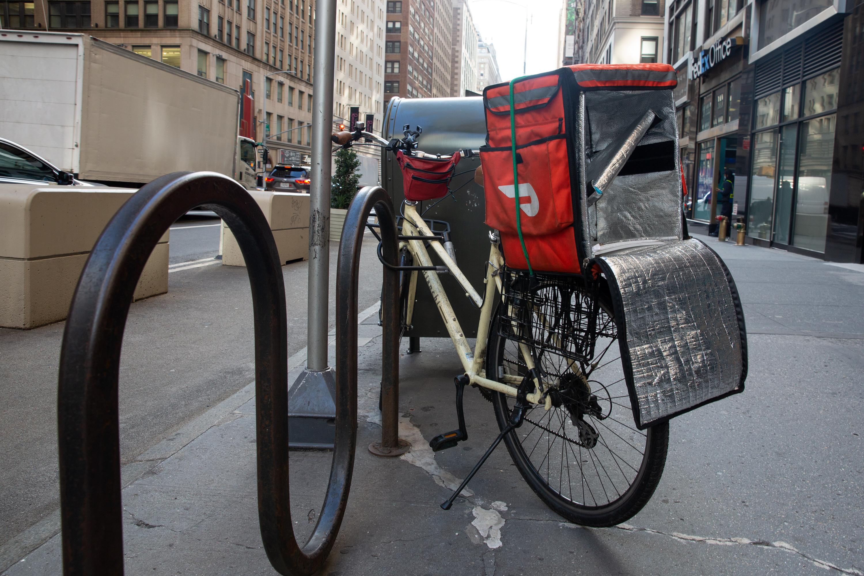 A worker delivers food in Midtown, Manhattan, Dec. 15, 2020.