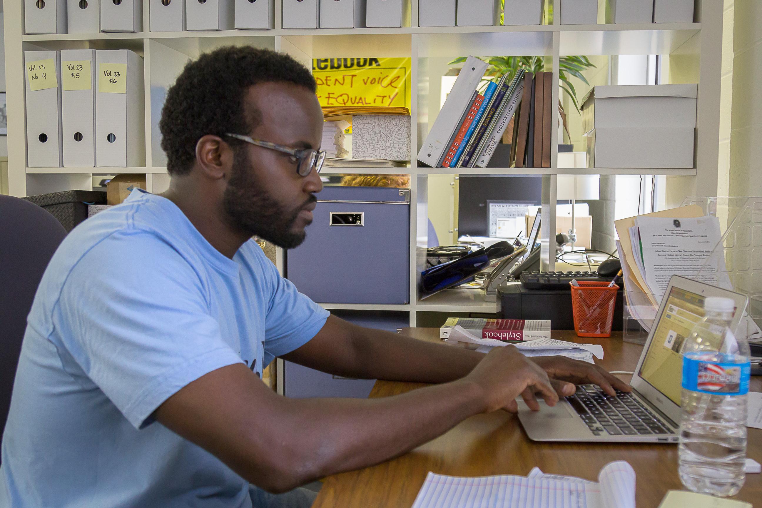 Darryl working on a laptop.