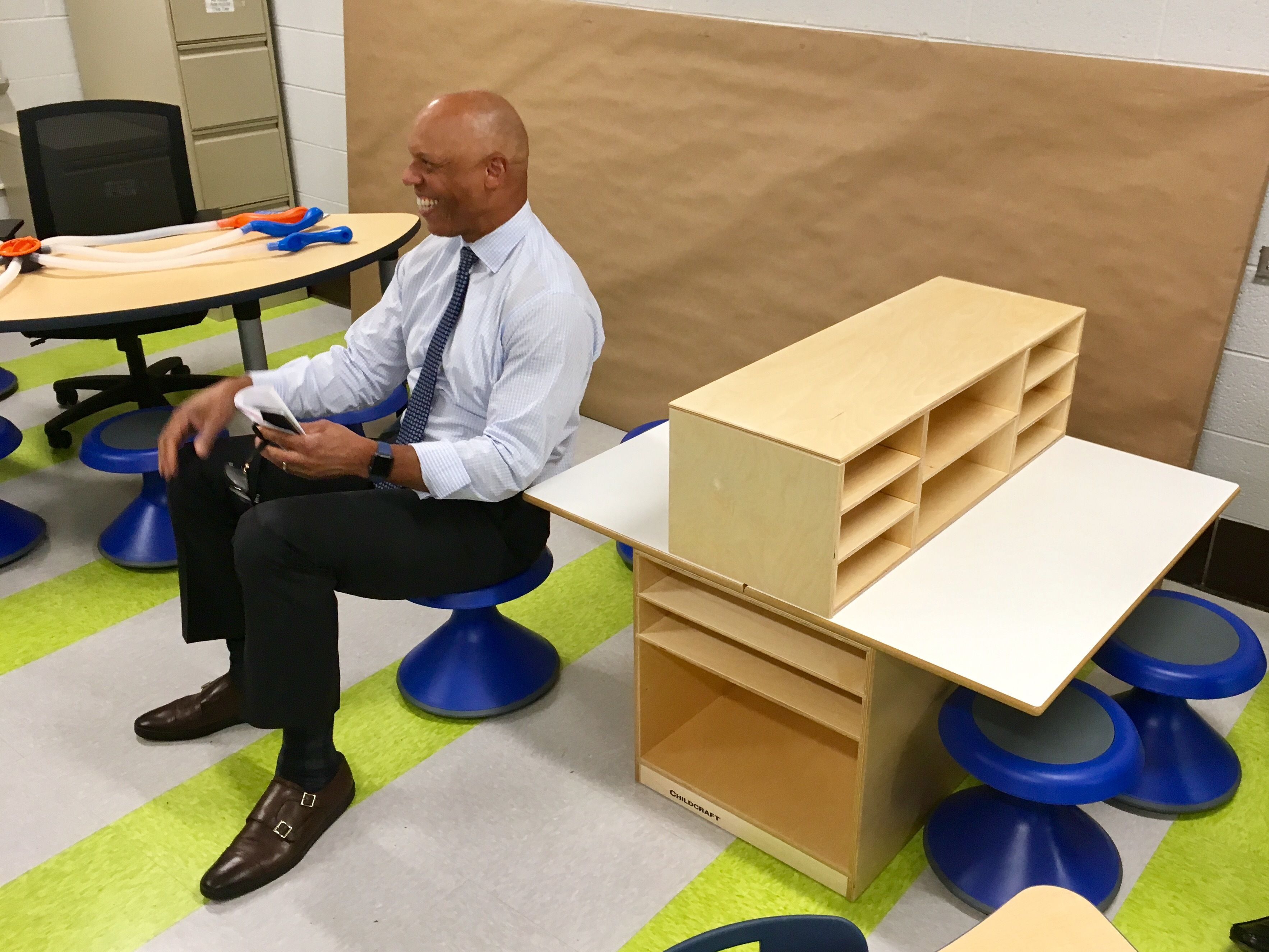 Superintendent William Hite sitting on a wobble seat.