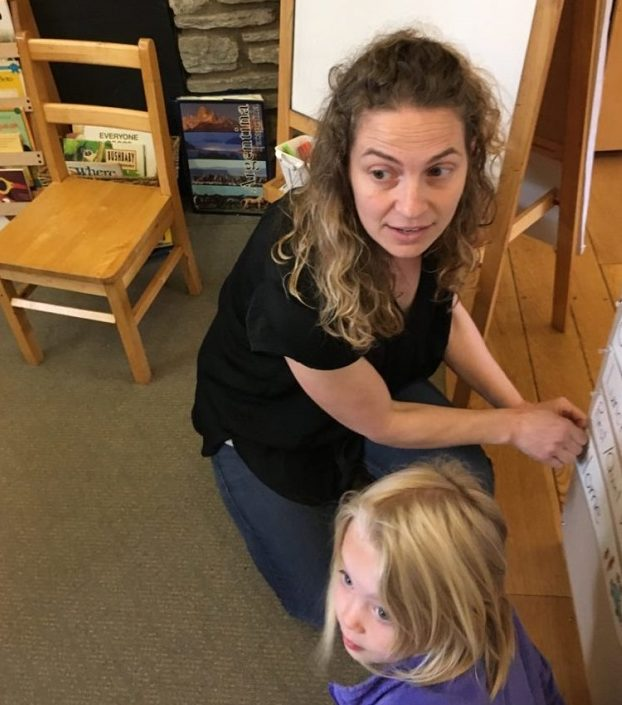 Cooperative Nursery School director Leah Corsover with a student.