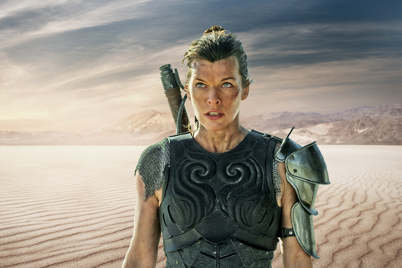 Actress Milla Jovovitch standing in a desert landscape