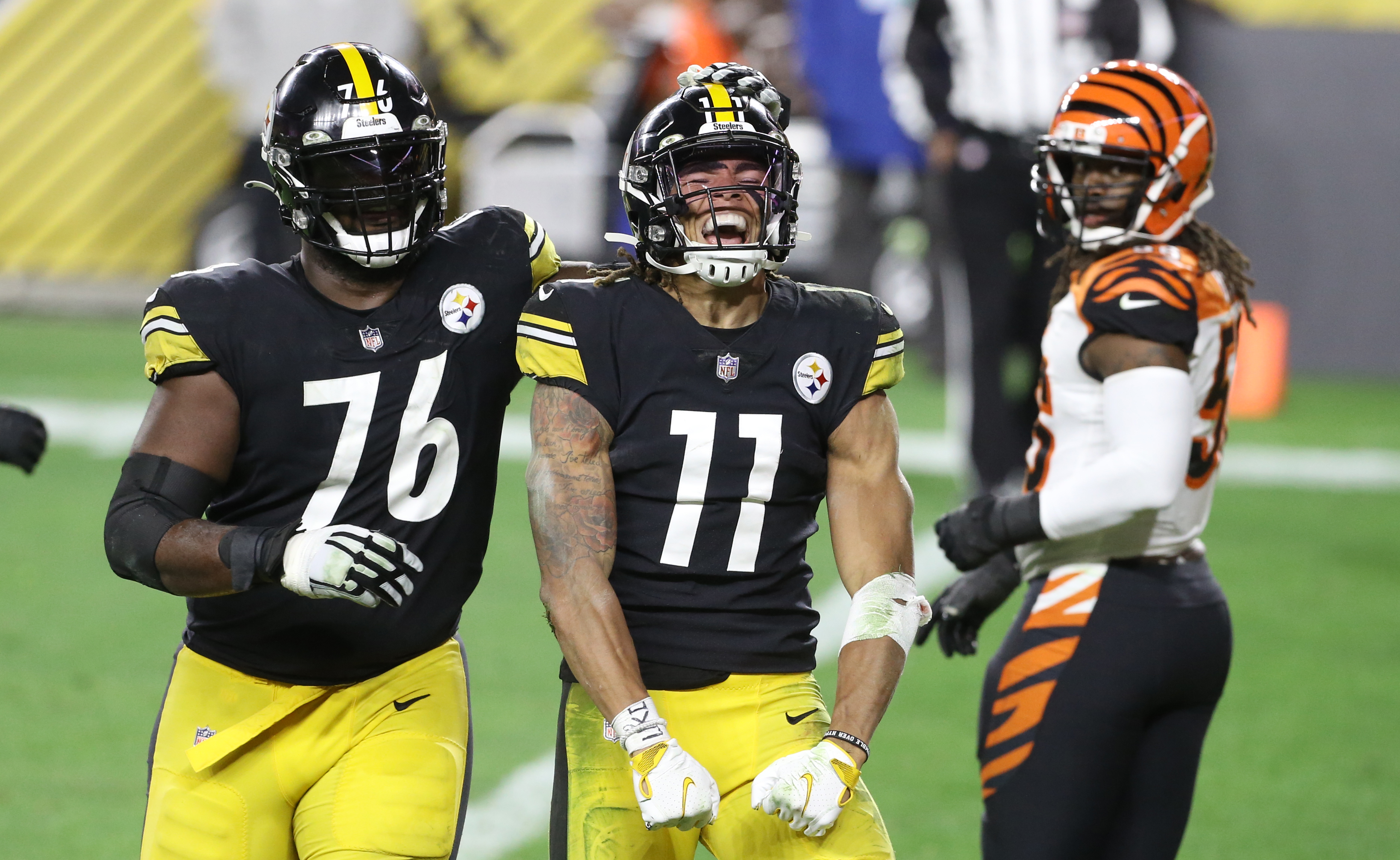 Pittsburgh Steelers offensive tackle Chukwuma Okorafor (76) celebrates a touchdown by wide receiver Chase Claypool (11) against the Cincinnati Bengals during the fourth quarter at Heinz Field. The Steelers won 36-10.