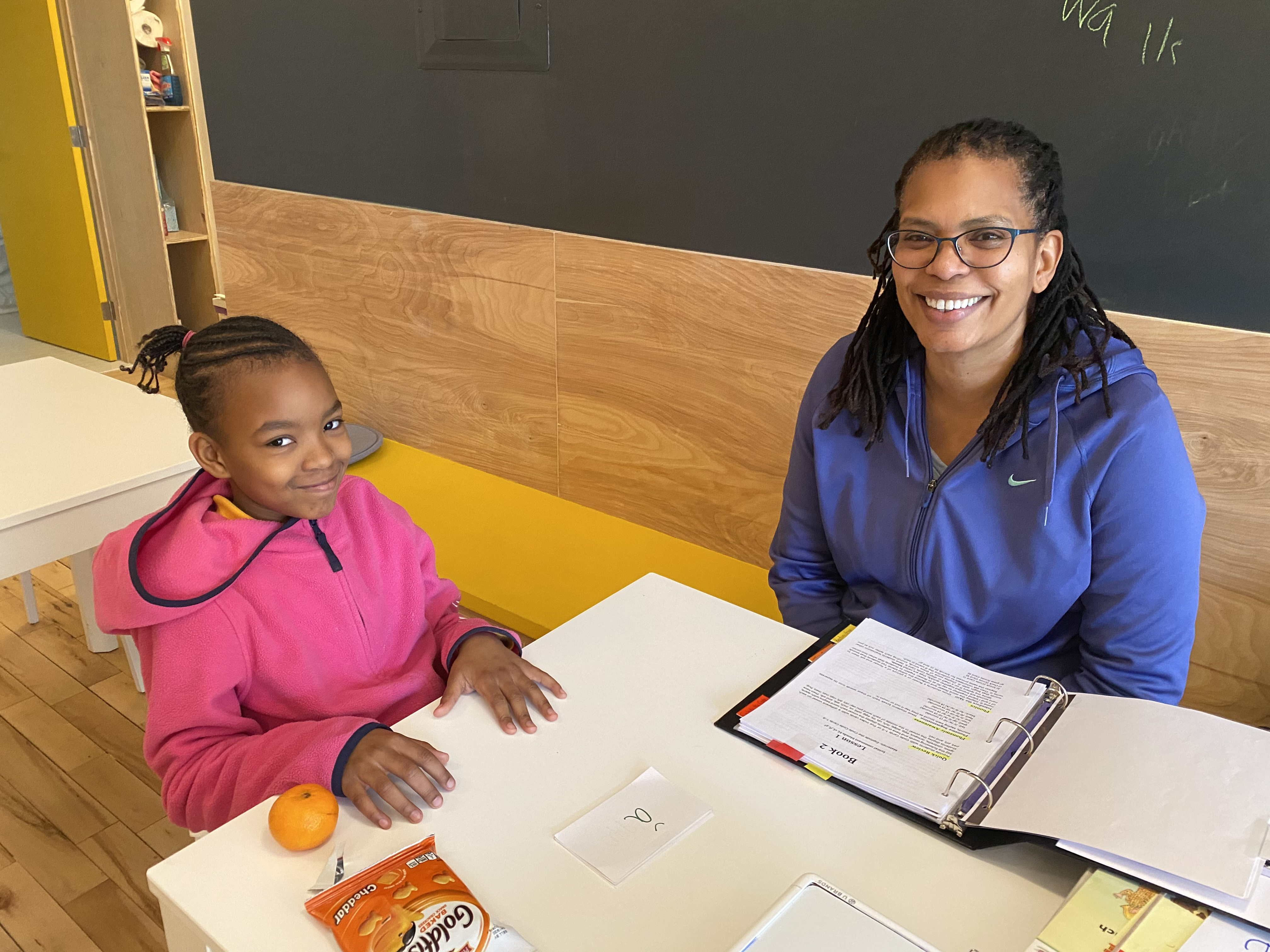 Taylor, a student at Read 718, at a tutoring session with Pam before the pandemic shut the organization's Downtown Brooklyn and Bedford-Stuyvesant locations.