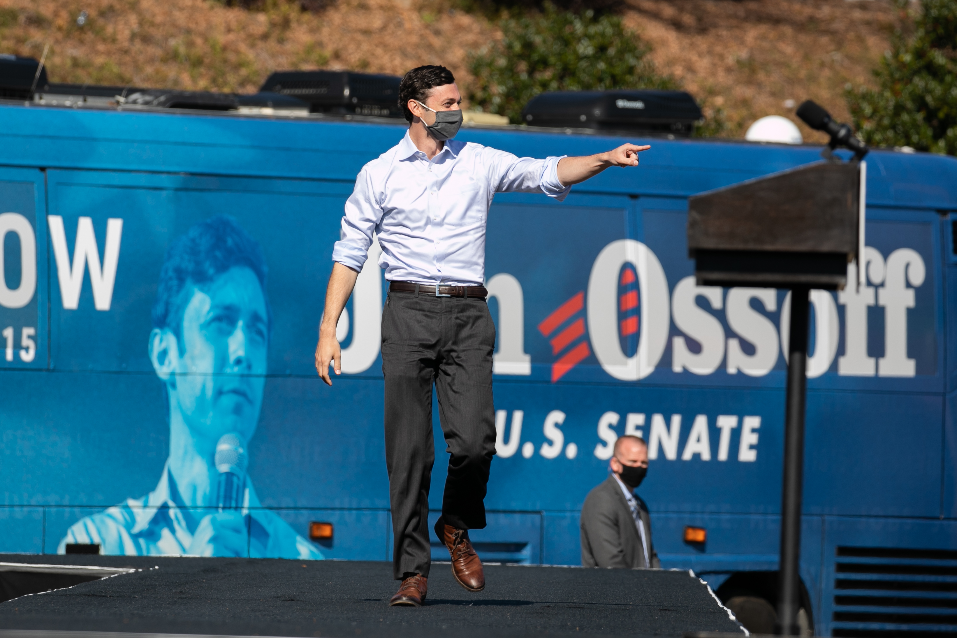 Georgia Democratic Senate candidate Jon Ossoff walks on stage during a drive-in rally at Bibb Mill Event Center on December 21, 2020 in Columbus, Georgia.