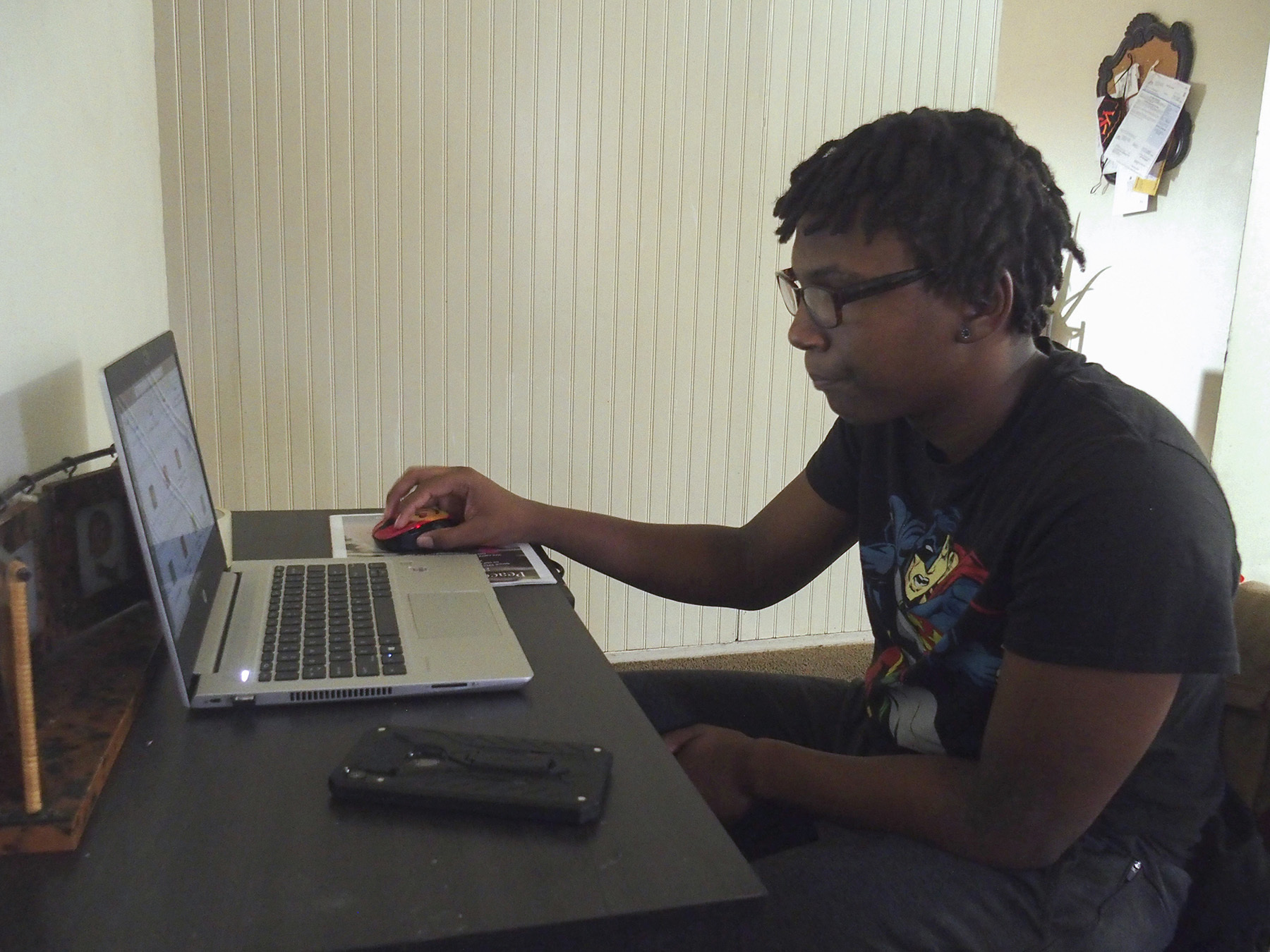 Jalan Clemmons working on his laptop computer at home.