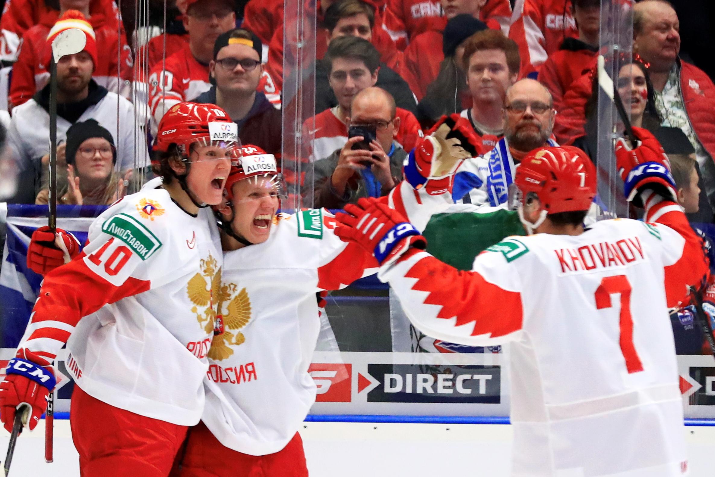 OSTRAVA, CZECH REPUBLIC - JANUARY 5, 2020: Russia's Dmitry Voronkov, Nikita Aleksandrov, and Alexander Khovanov (L-R) celebrate a goal in the 2020 World Junior Ice Hockey Championship final match between Canada and Russia at Ostravar Arena.