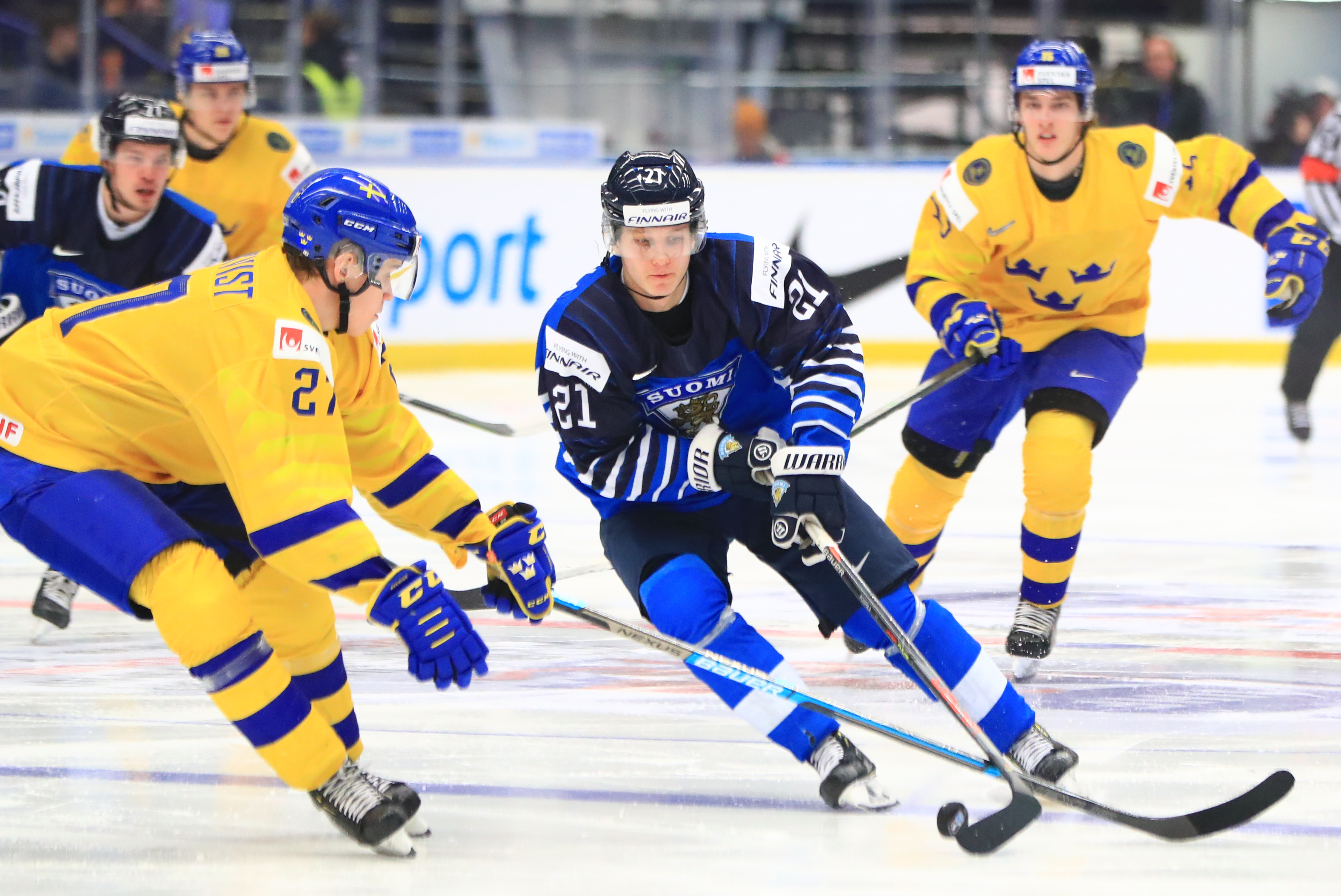 OSTRAVA, CZECH REPUBLIC - JANUARY 5, 2020: Sweden's Nils Hoglander (L front), and Finland's Patrik Puistola (C) in the 2020 IIHF World Junior Ice Hockey Championship bronze medal match between Sweden and Finland at Ostravar Arena.