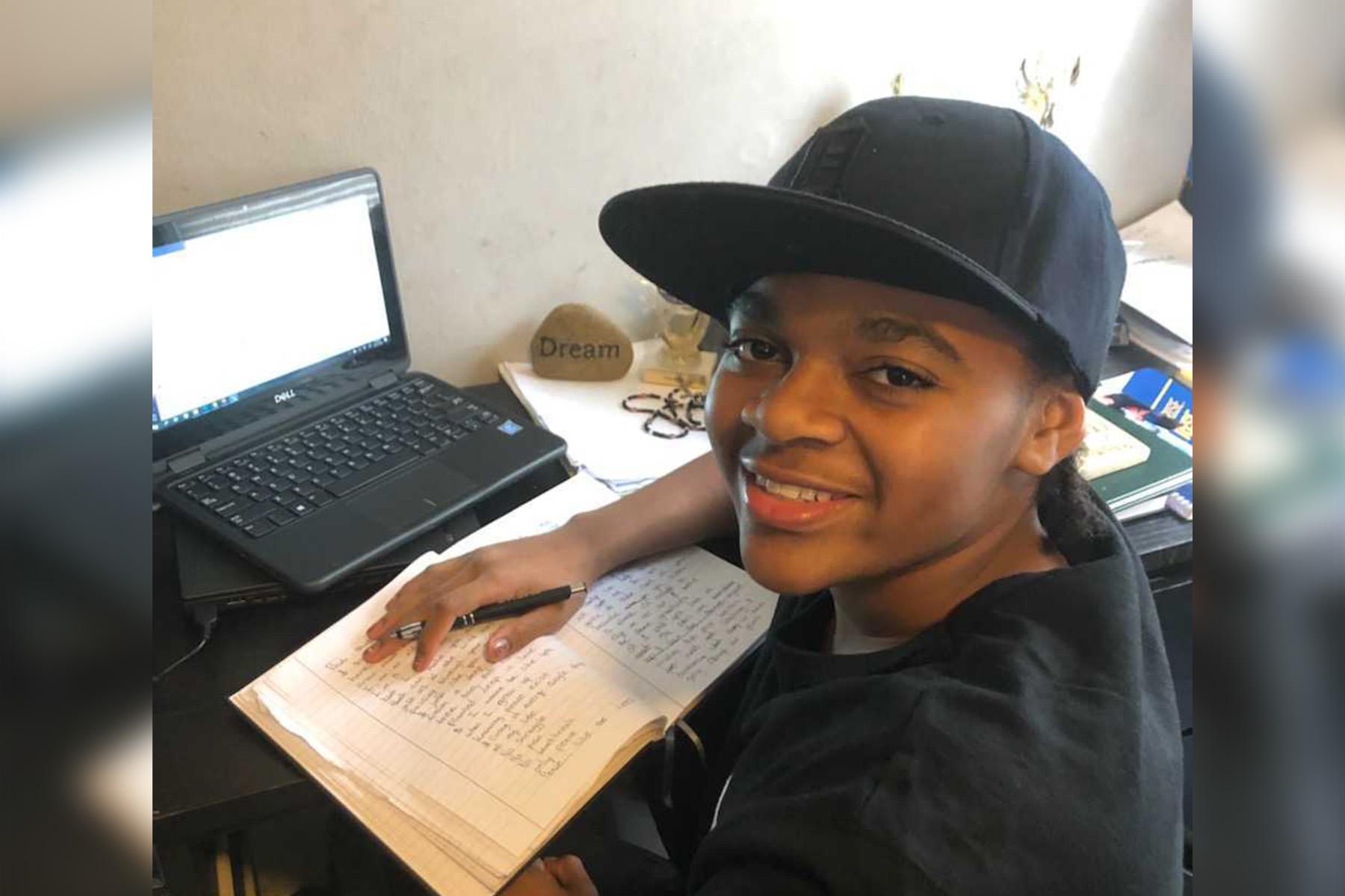King Bethel smiling at his desk at home.