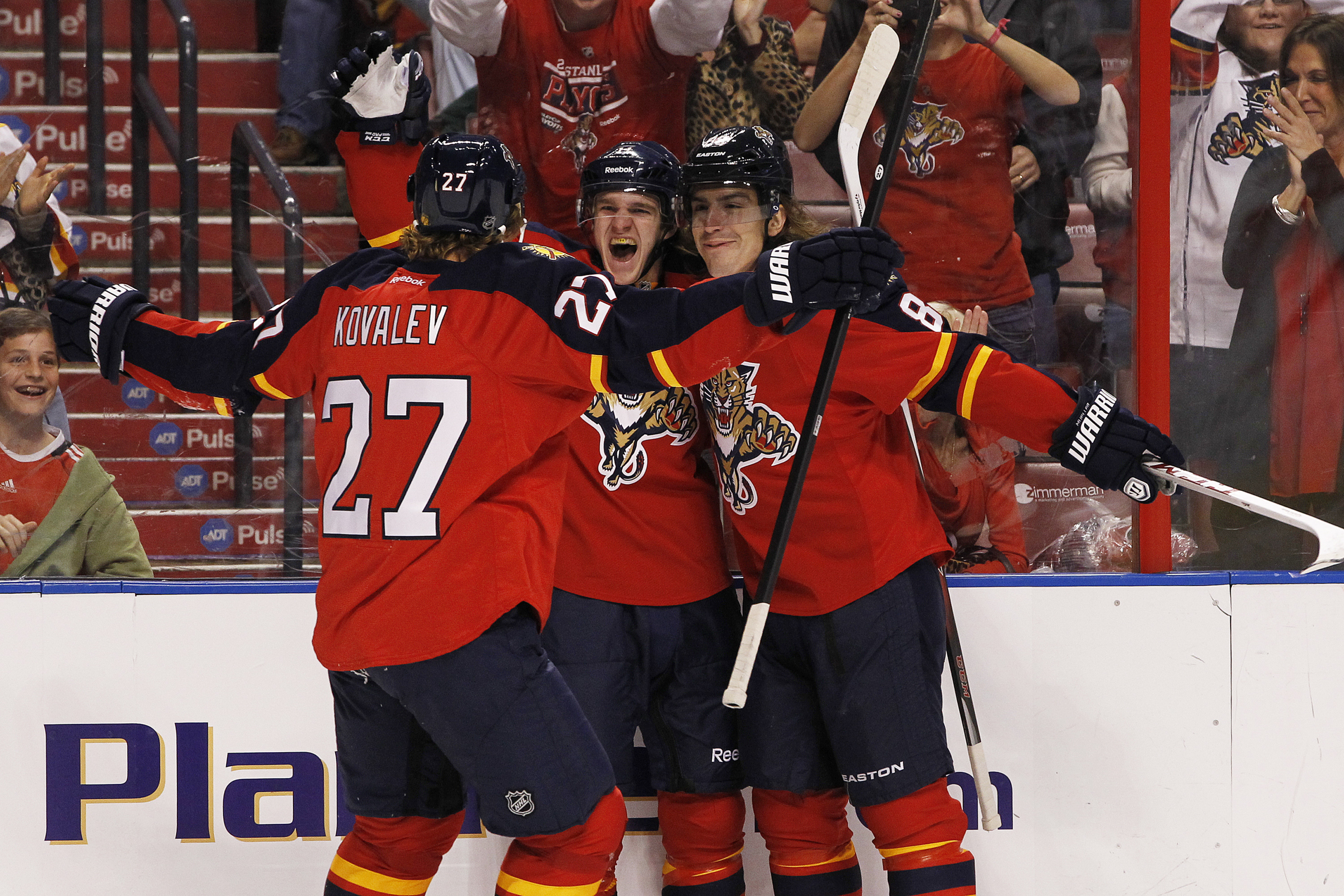 Florida Panthers rookie Jonathan Huberdeau, center, introduced himself to the Southeast Division with a goal and 2 assists in his professional debut at age 19 last night.