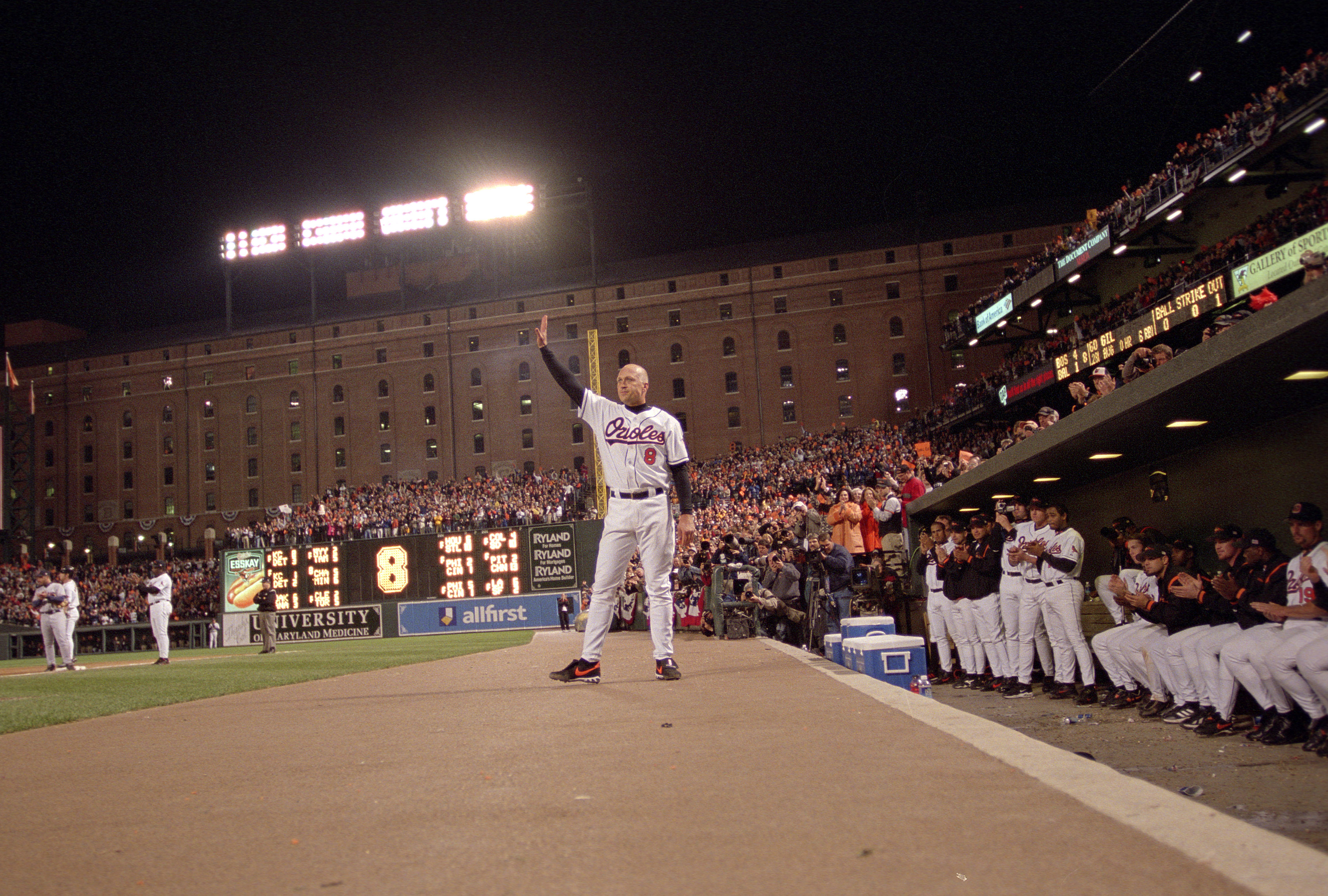 Baseball Hall of Famer Cal Ripken Jr. waves to the crowd as he leaves the final game of his career.
