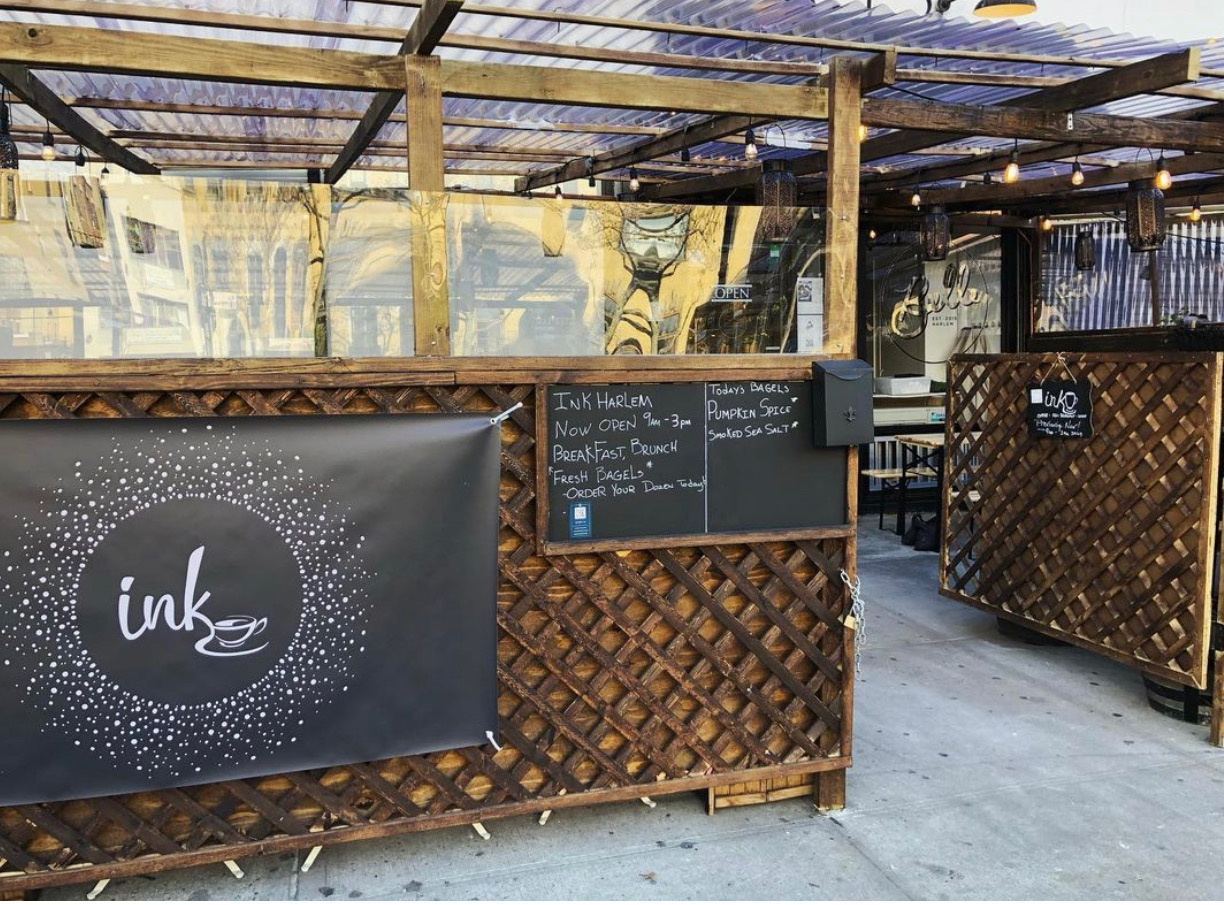 The exterior of the cafe Ink, in Harlem, which has a bamboo enclosure
