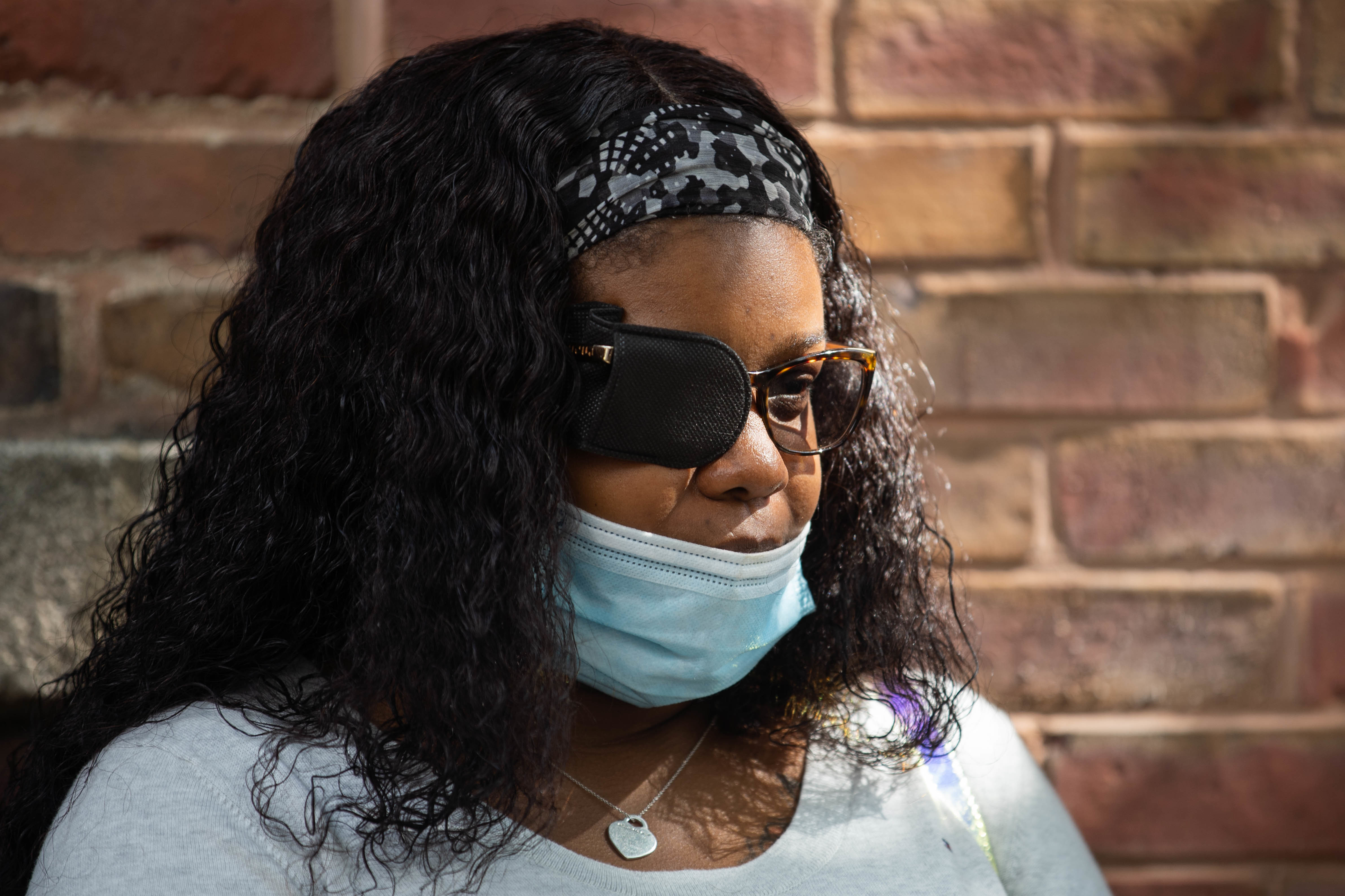 Mia Wright, who said a police officer grabbed her out of her car by her hair and knelt on her neck outside Brickyard Mall, attends a press conference near 314 N. Loomis St. on Sept. 29, 2020.