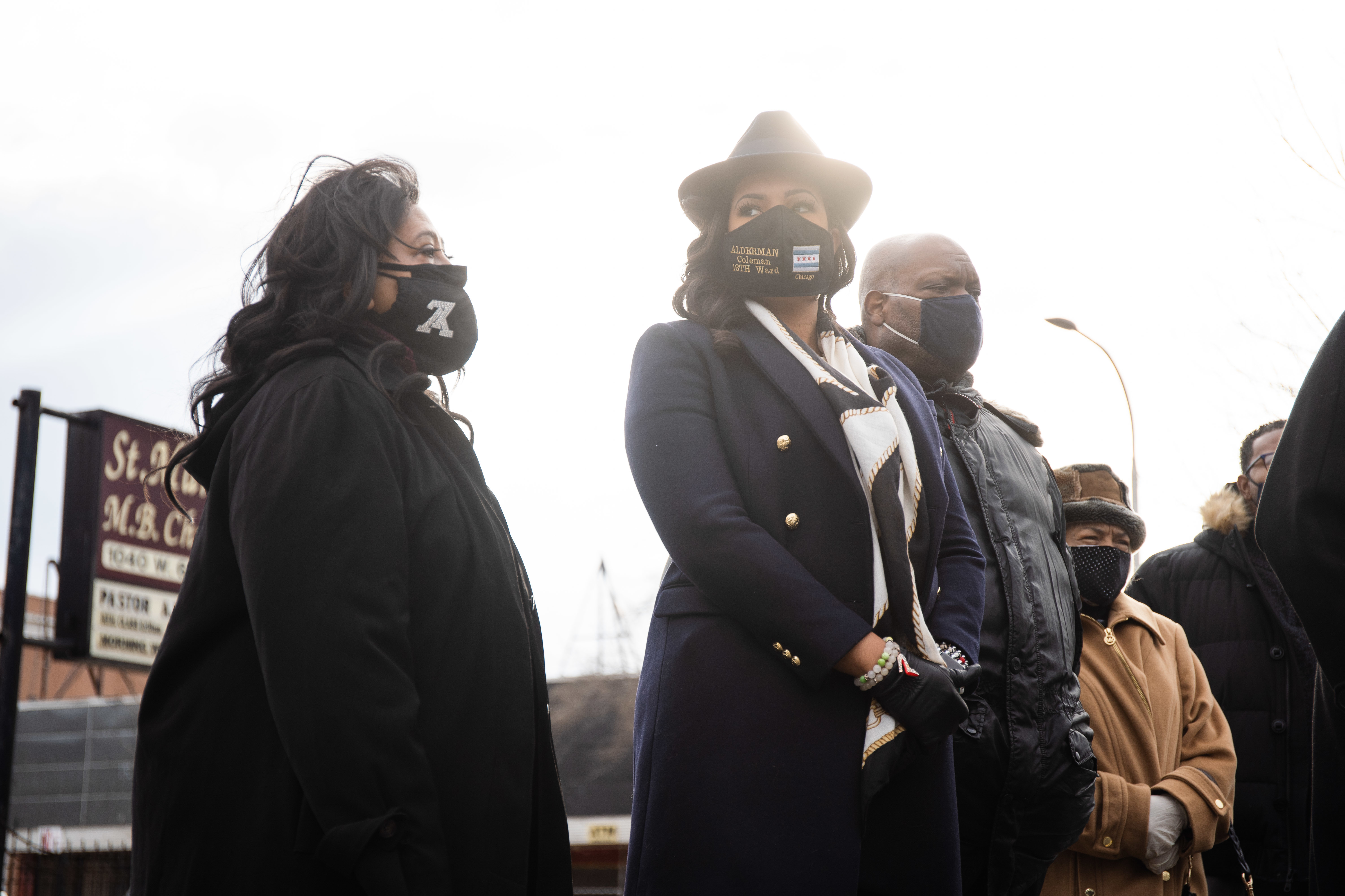 """Stephanie Coleman (16th), second from left, stands with religious leaders who call on Mayor Lori Lightfoot to """"come clean"""" about the botched raid in Anjanette Young's home."""