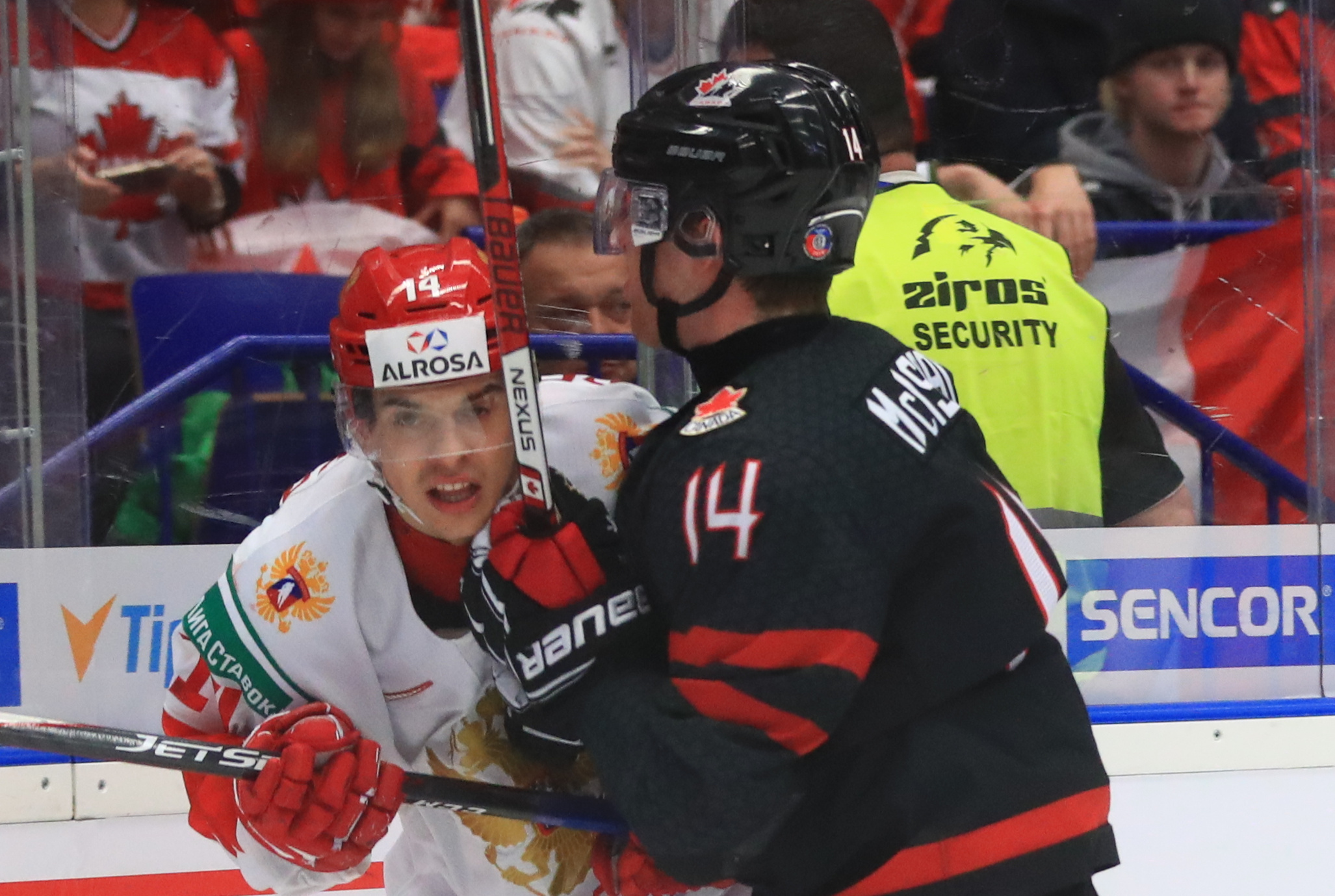OSTRAVA, CZECH REPUBLIC - JANUARY 5, 2020: Russia's Grigory Denisenko (L) and Canada's Jared McIsaac in the 2020 World Junior Ice Hockey Championship final match between Canada and Russia at Ostravar Arena.