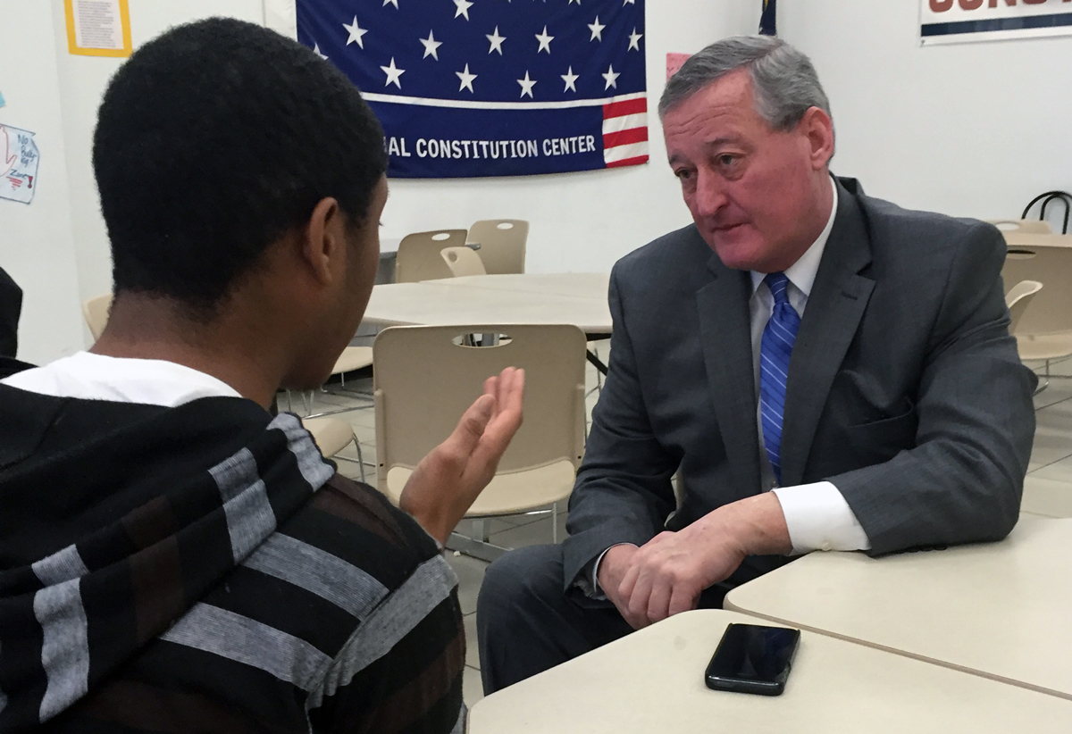 Jim Kenney and a student having a conversation in a classroom.