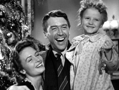 """Donna Reed, James Stewart and Karolyn Grimes in the 1946 film """"It's a Wonderful Life."""""""