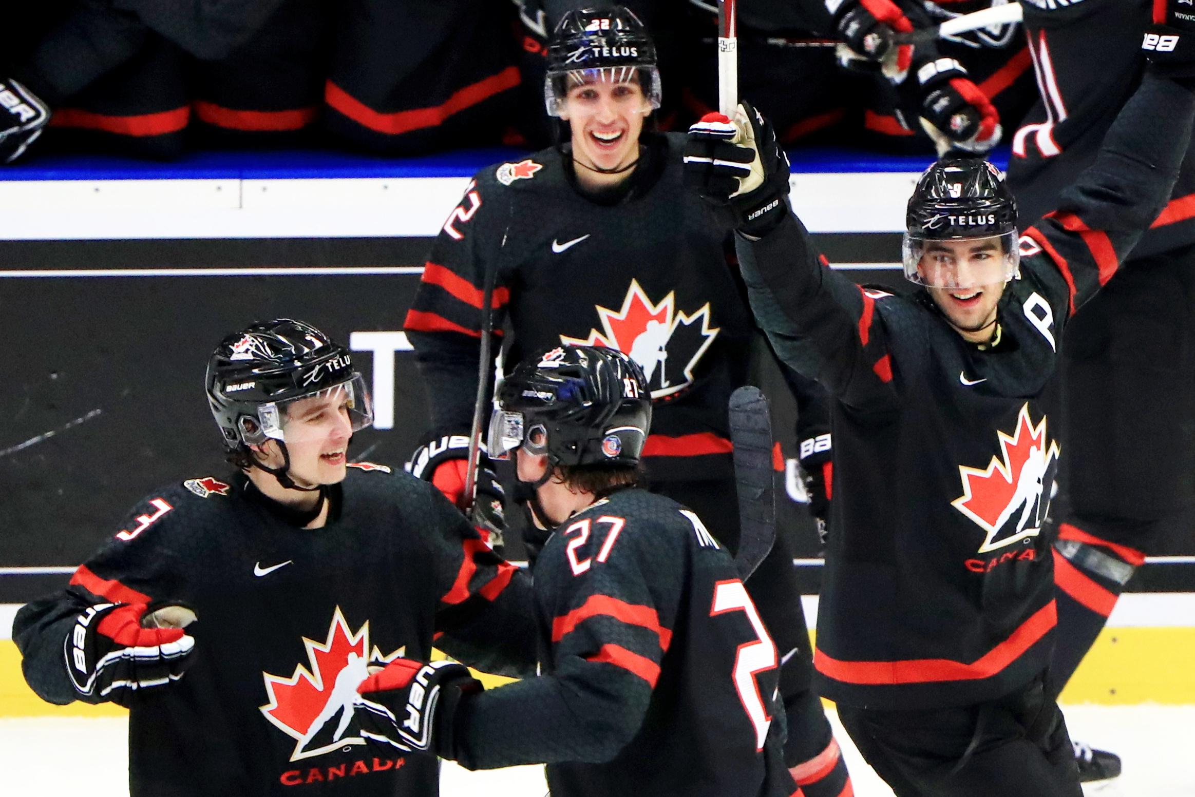 OSTRAVA, CZECH REPUBLIC - JANUARY 5, 2020: Canada's Calen Addison, Barrett Hayton, Joe Veleno (L-R front) and teammates celebrate a goal in the 2020 World Junior Ice Hockey Championship final match between Canada and Russia at Ostravar Arena.