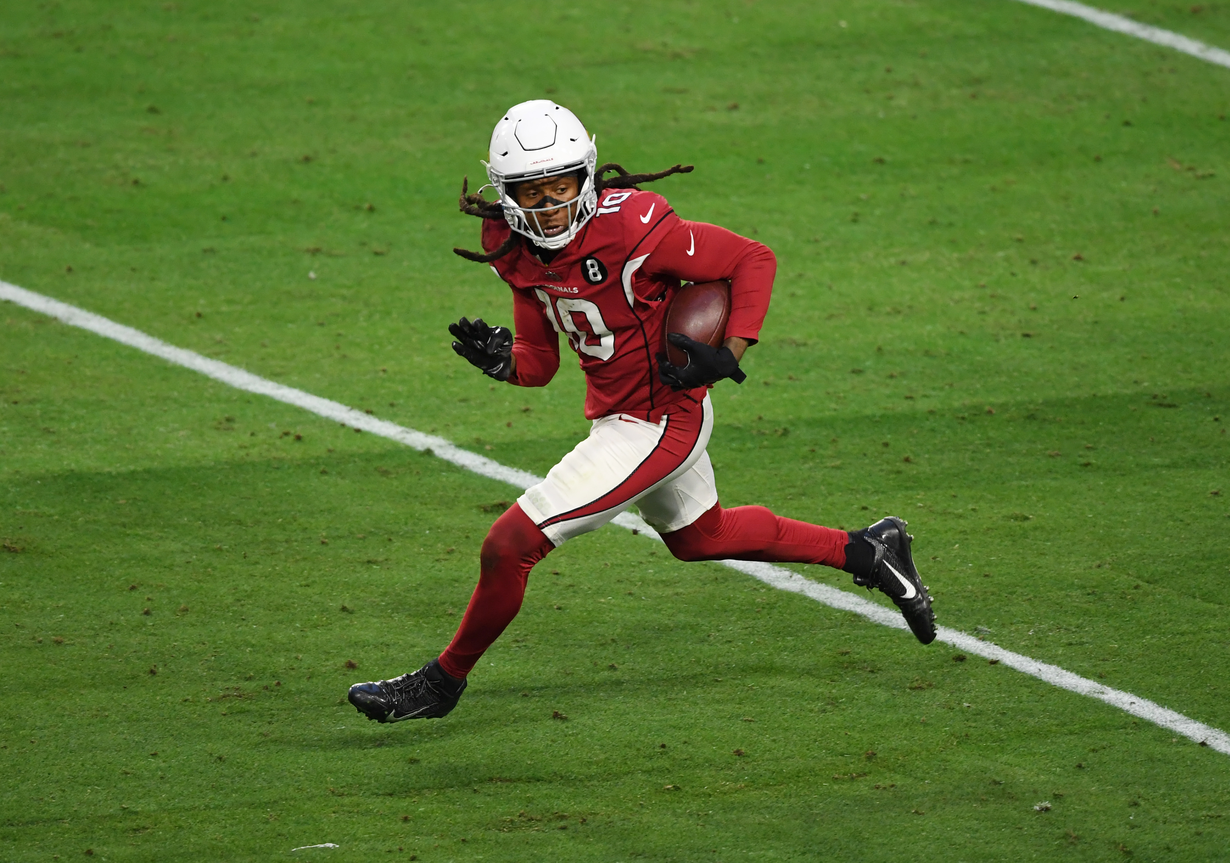 DeAndre Hopkins #10 of the Arizona Cardinals runs with the ball against the Philadelphia Eagles at State Farm Stadium on December 20, 2020 in Glendale, Arizona.