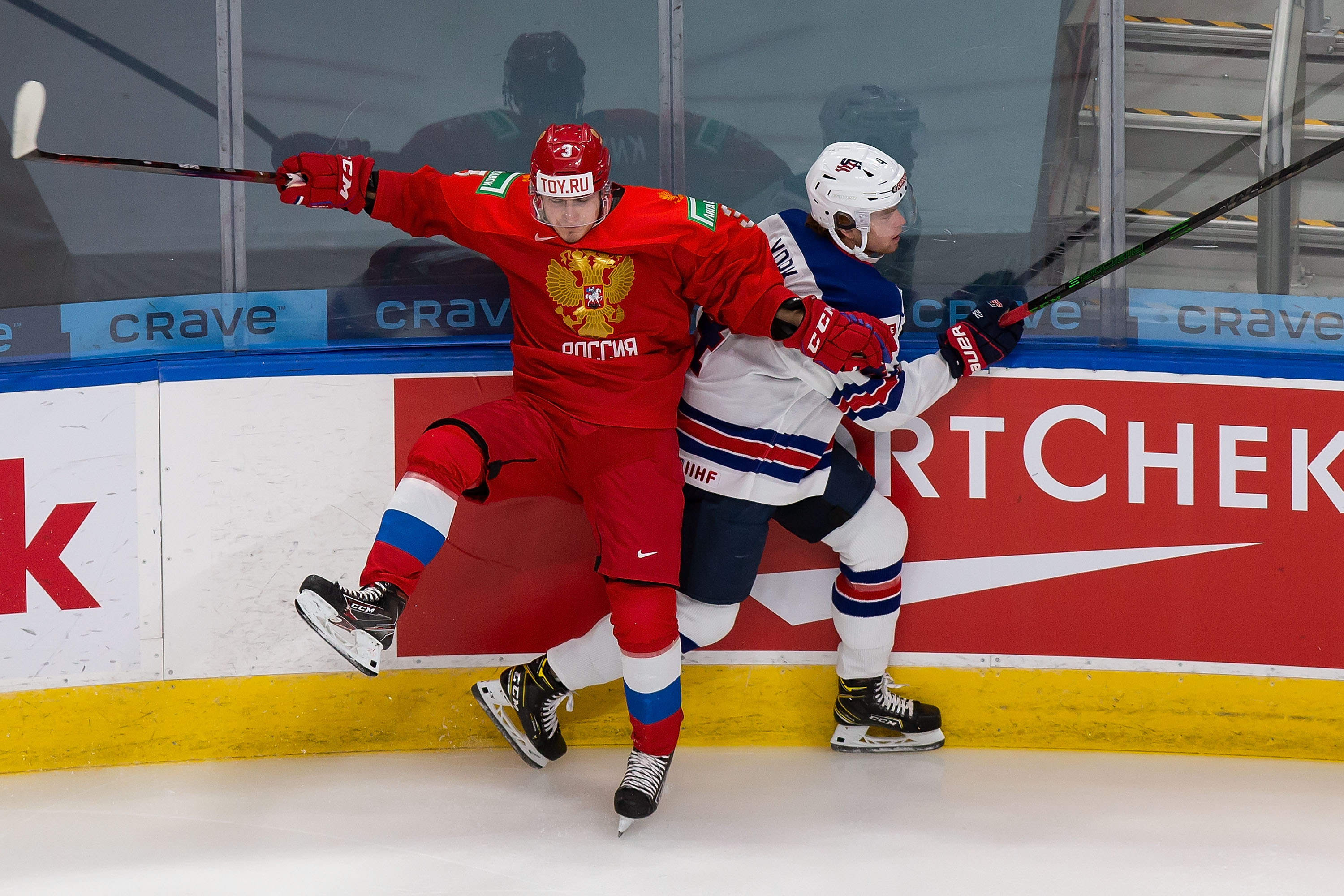 Artemi Knyazev #3 of Russia collides with Cam York #4 of the United States during the 2021 IIHF World Junior Championship at Rogers Place on December 25, 2020 in Edmonton, Canada.