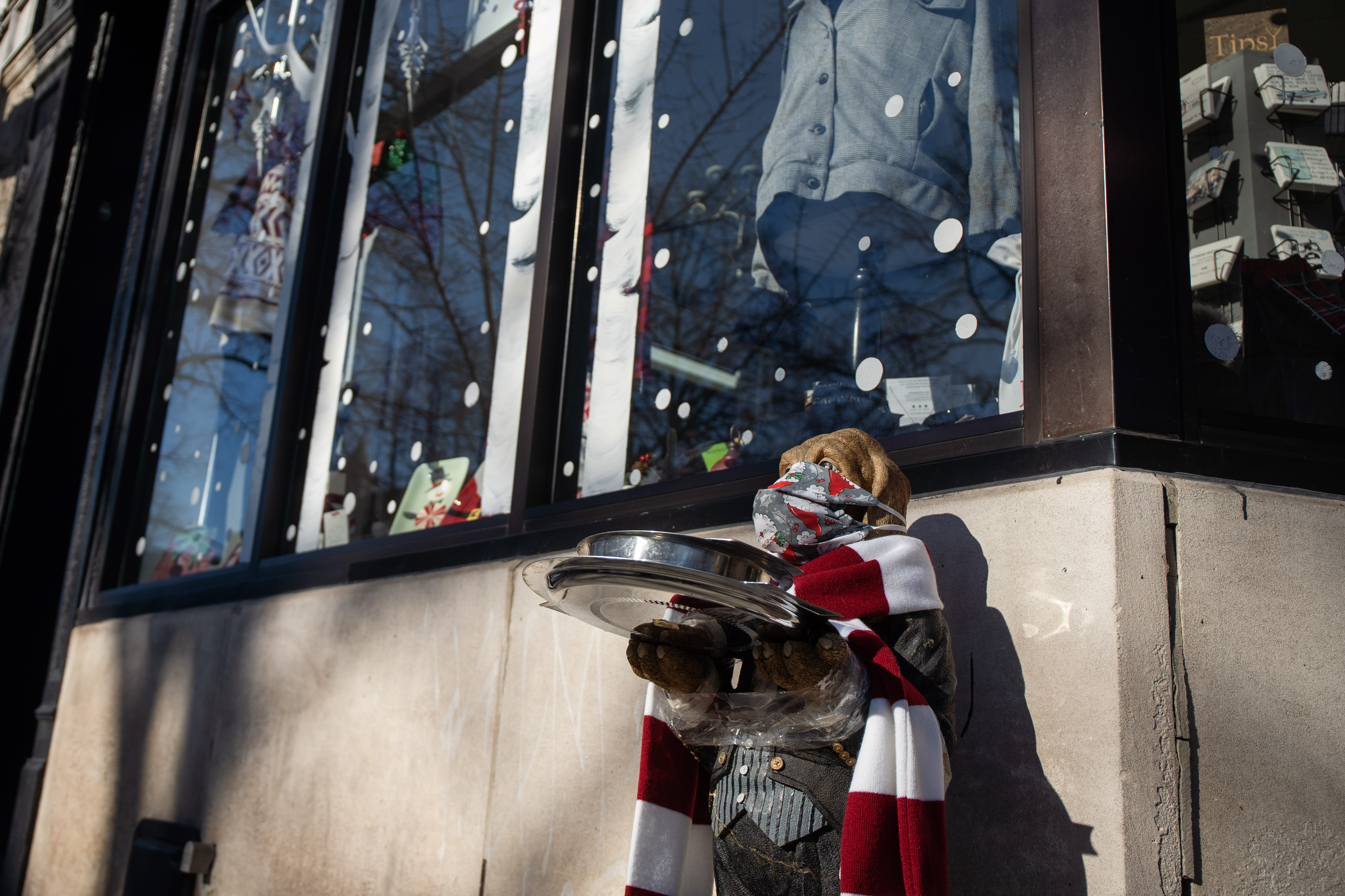 A statue of a masked dog stands outside Moondance, located at 2010 W. Roscoe St., which is participating in the Roscoe Village Chamber of Commerce's holiday window display contest, Saturday afternoon, Dec. 26, 2020.