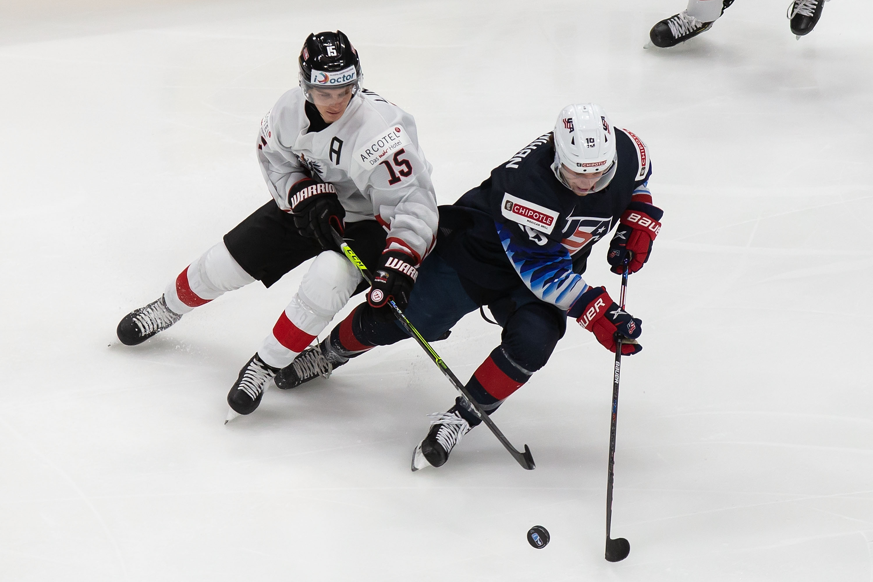 Patrick Moynihan #19 of the United States skates against Luis Lindner #15 of Austria during the 2021 IIHF World Junior Championship at Rogers Place on December 26, 2020 in Edmonton, Canada.