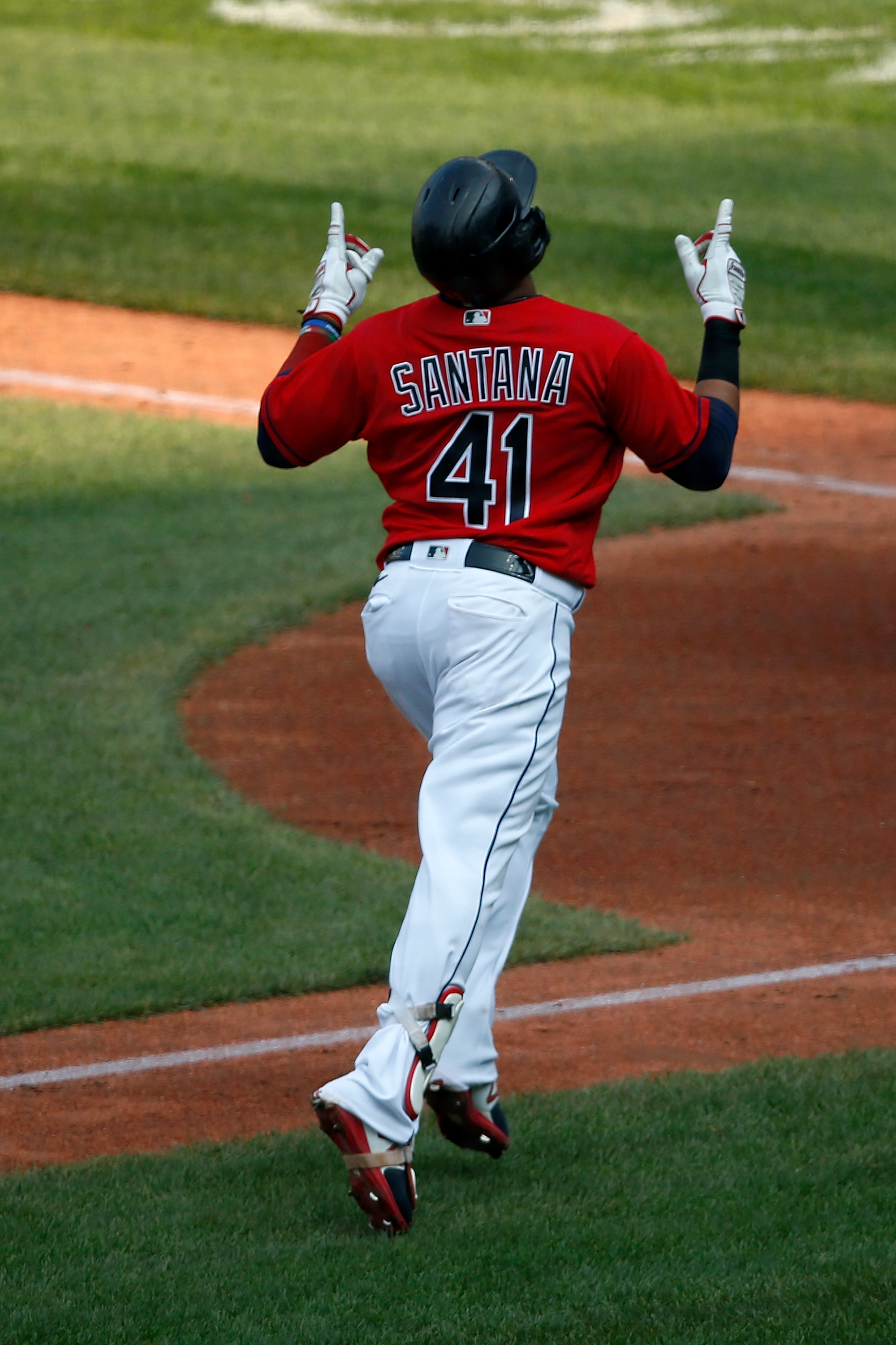 Carlos Santana #41 of the Cleveland Indians celebrates a home run while running the bases during the game against the Pittsburgh Pirates at Progressive Field on September 27, 2020 in Cleveland, Ohio.