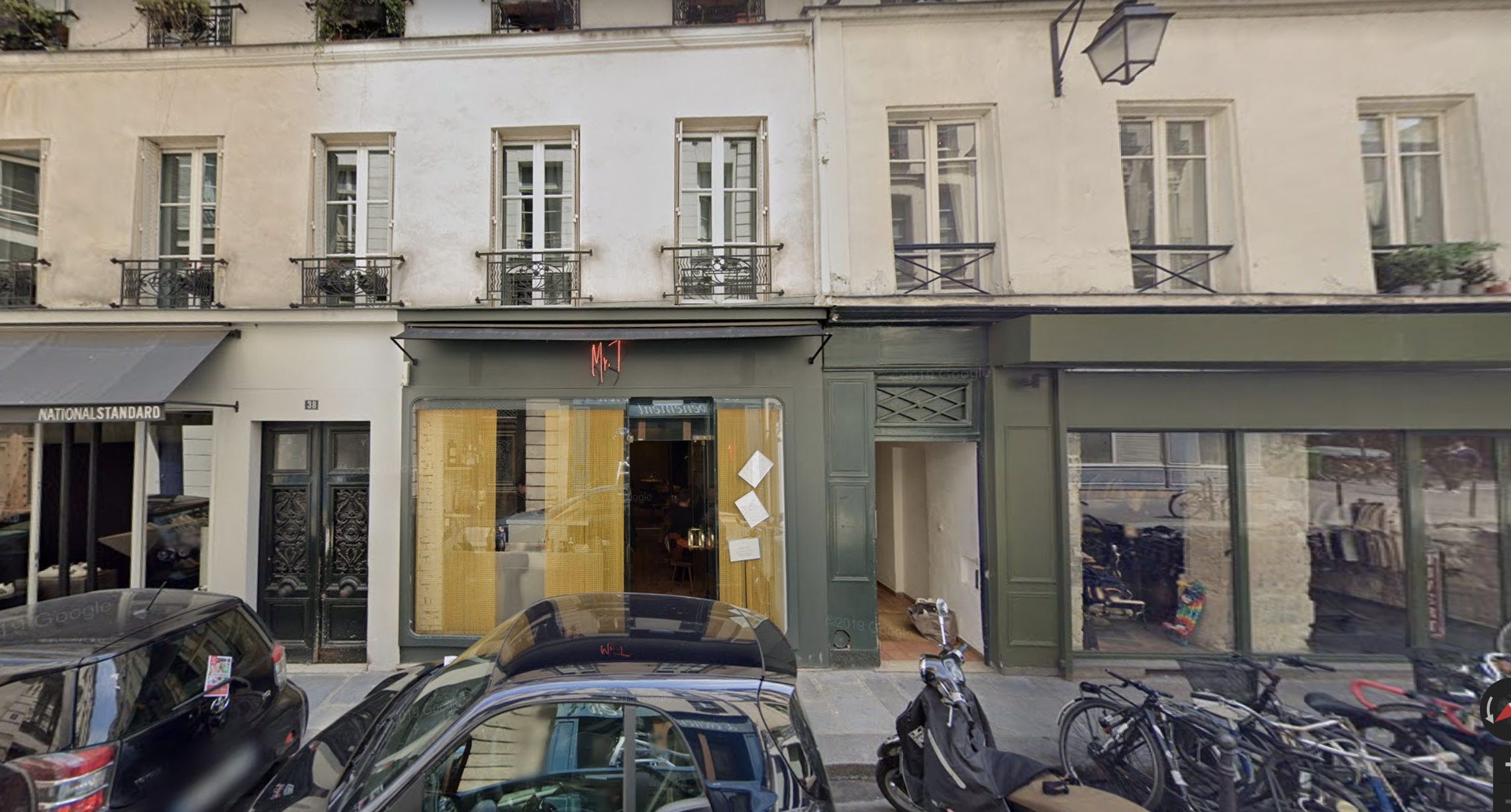 A street view image of a closed Parisian restaurant at daytime.