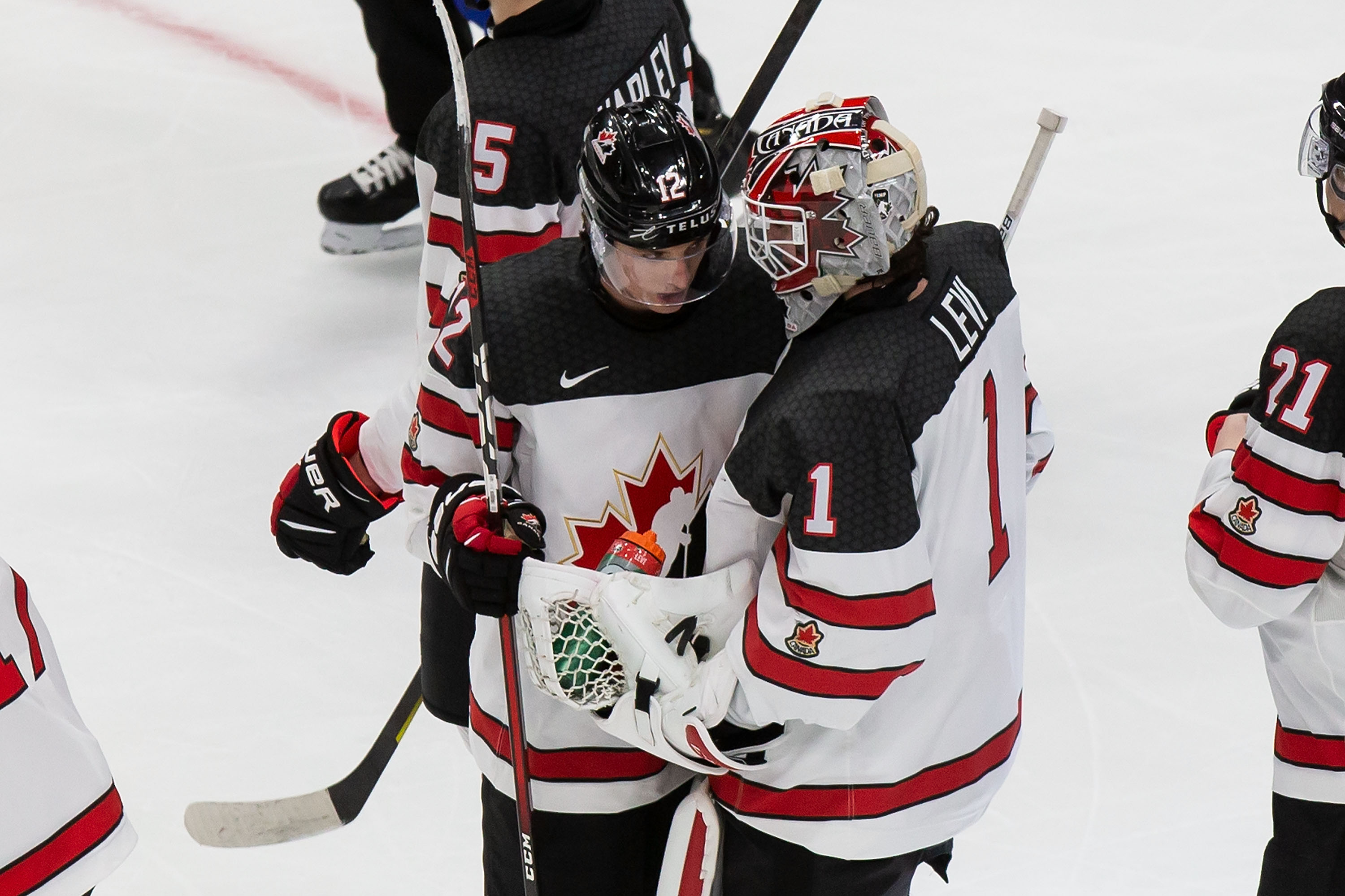 Jakob Pelletier #12 and goaltender Devon Levi #1 of Canada celebrate their victory over Slovakia during the 2021 IIHF World Junior Championship at Rogers Place on December 27, 2020 in Edmonton, Canada.