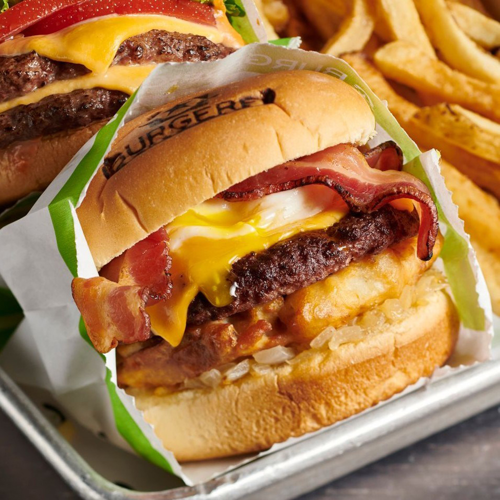 """BurgerFi's """"breakfast all day burger,"""" featuring bacon, cheese, maple syrup, a fried egg and a hash brown, coming soon to Henderson."""