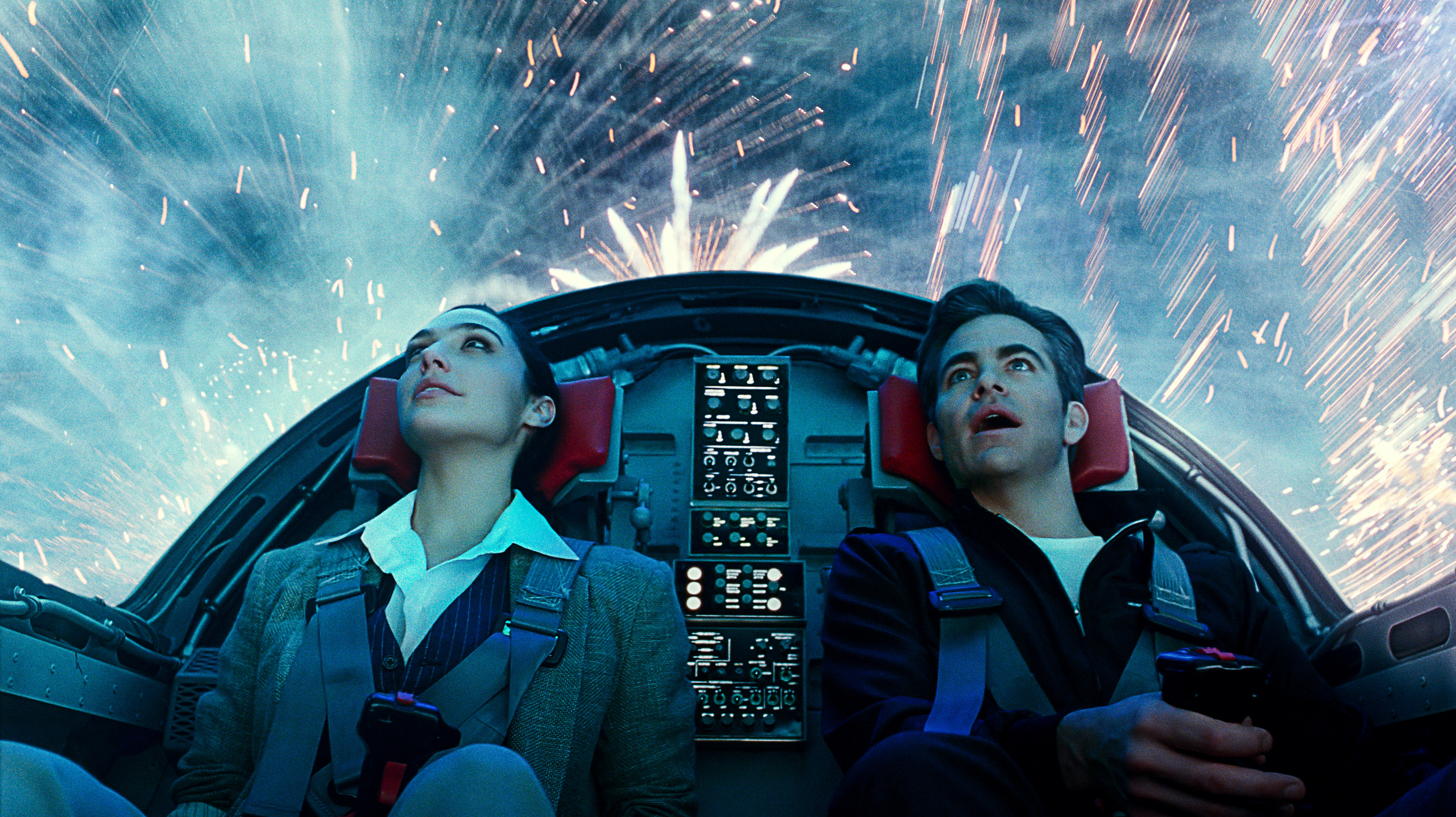 """This image released by Warner Bros. Entertainment shows Gal Gadot, left, and Chris Pine in a scene from """"Wonder Woman 1984."""""""