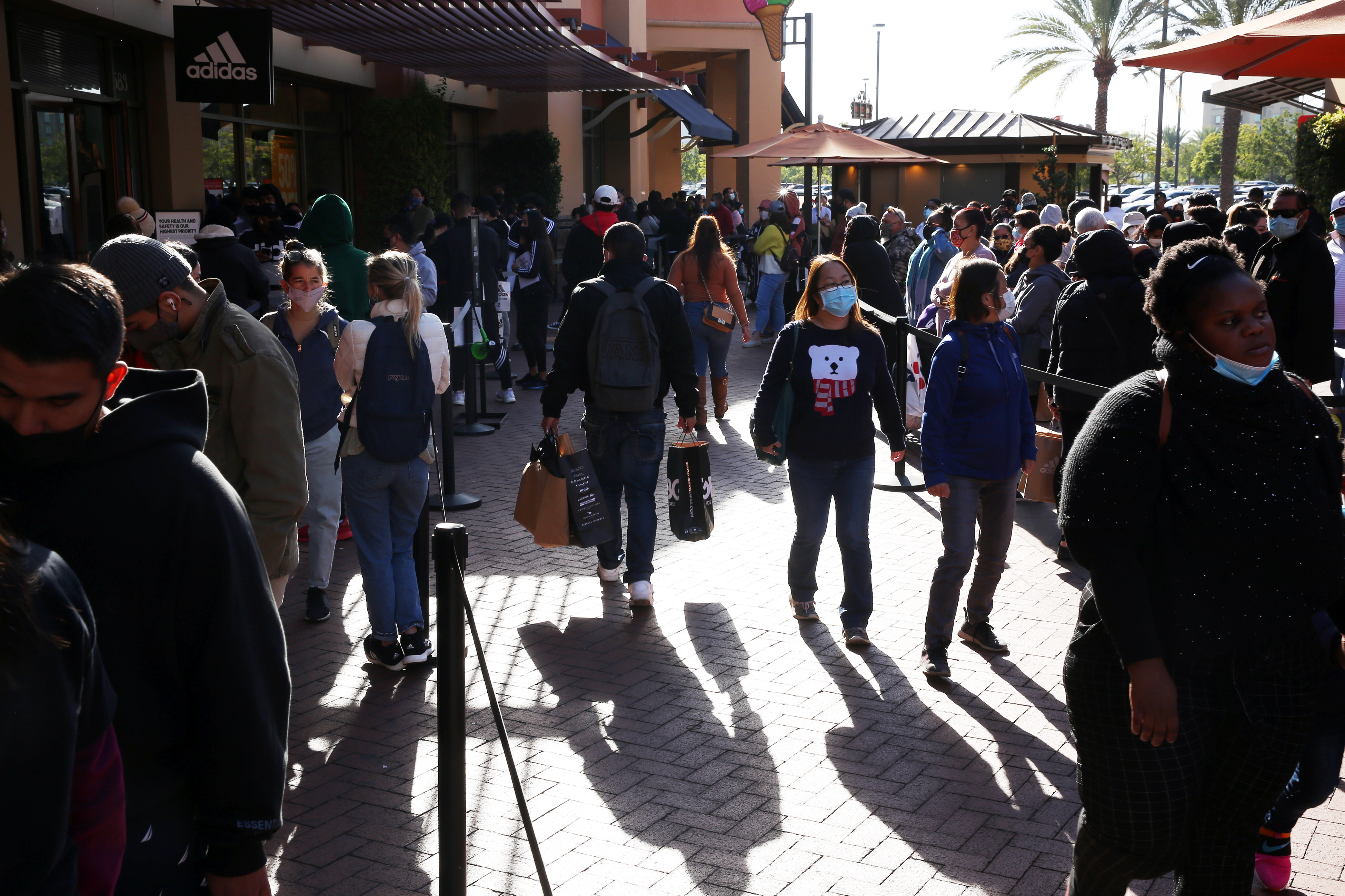 People shop at the Citadel Outlets in Commerce on Friday, Nov. 27, 2020 in Los Angeles, CA.