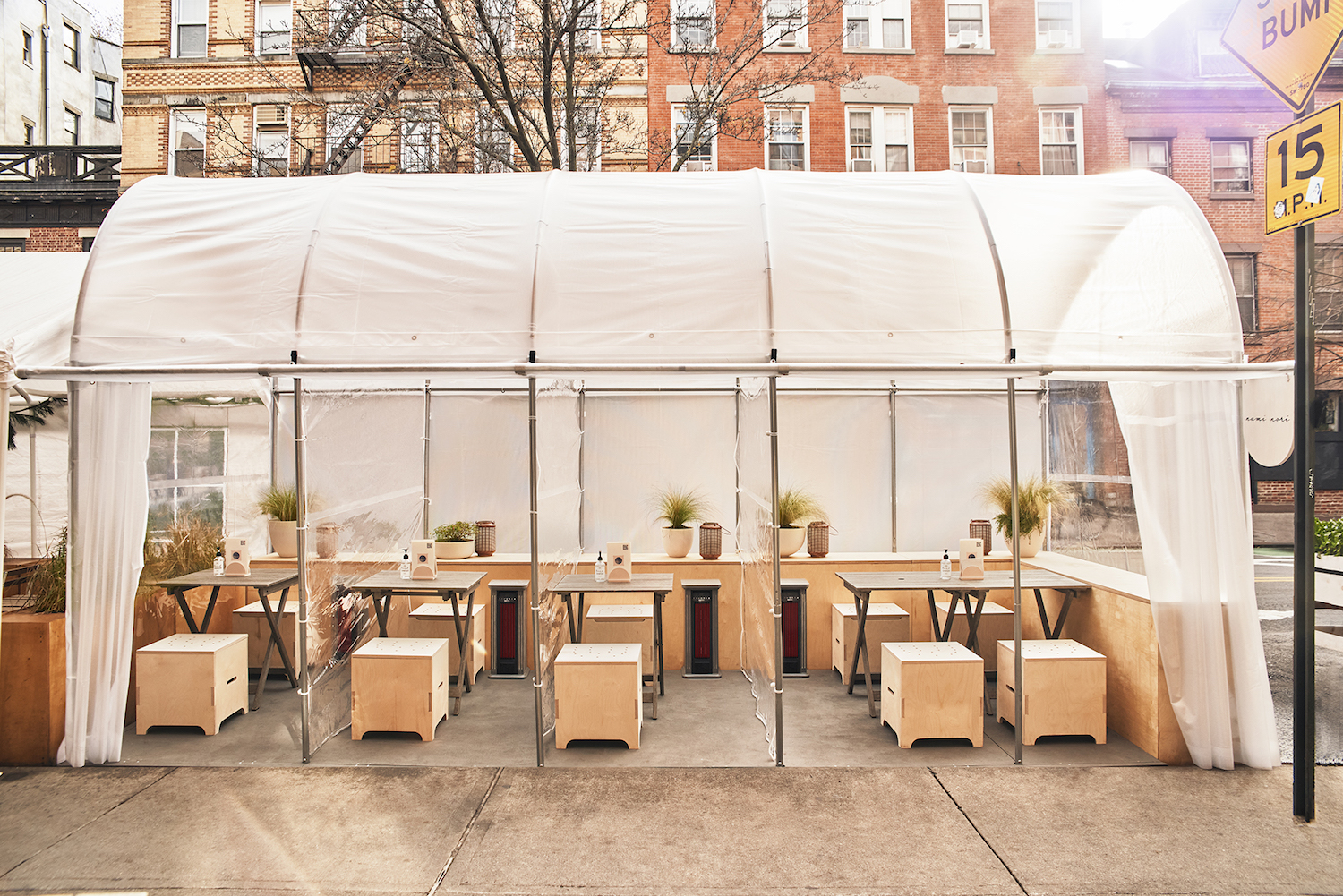 The exterior of Nami Nori which has a semi circular tent covering tables and chairs