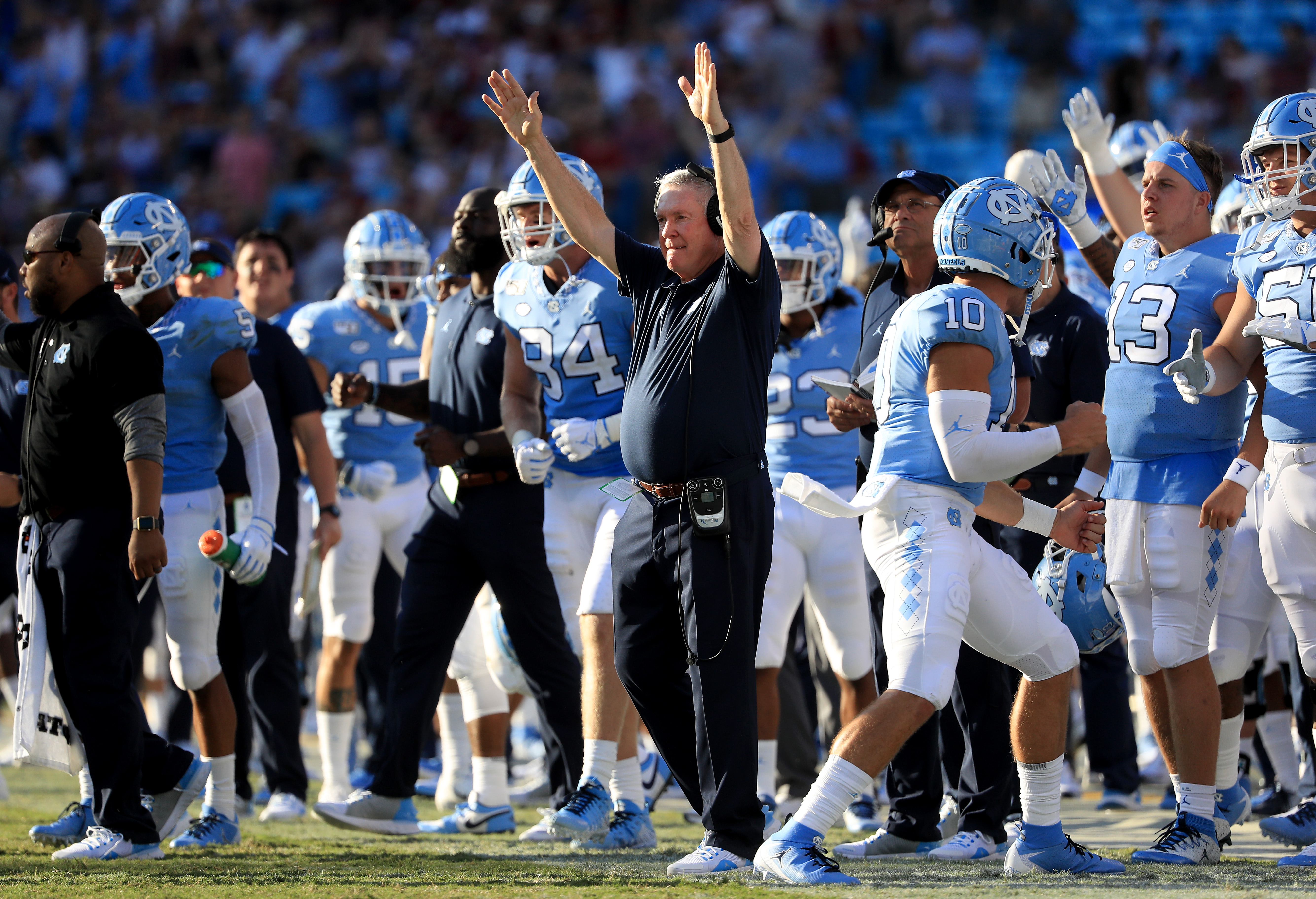 Head coach Mack Brown of the North Carolina Tar Heels reacts after his team scores against the South Carolina Gamecocks during the Belk College Kickoff game at Bank of America Stadium on August 31, 2019 in Charlotte, North Carolina.