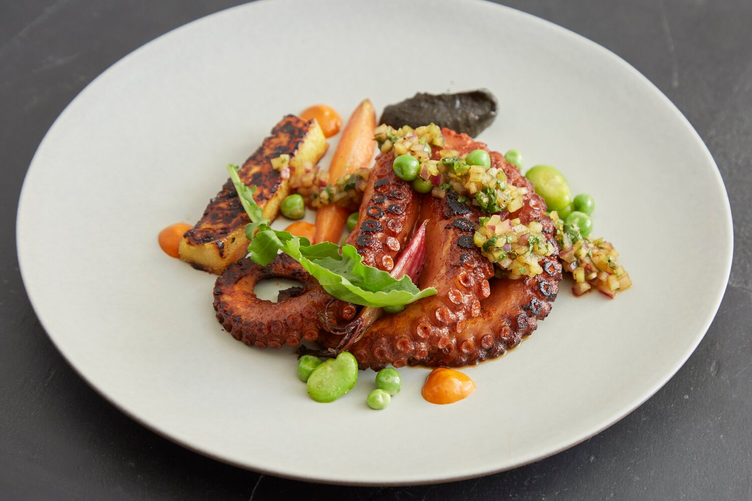 A plate of octopus from incoming 14th Street NW restaurant Maiz 64.