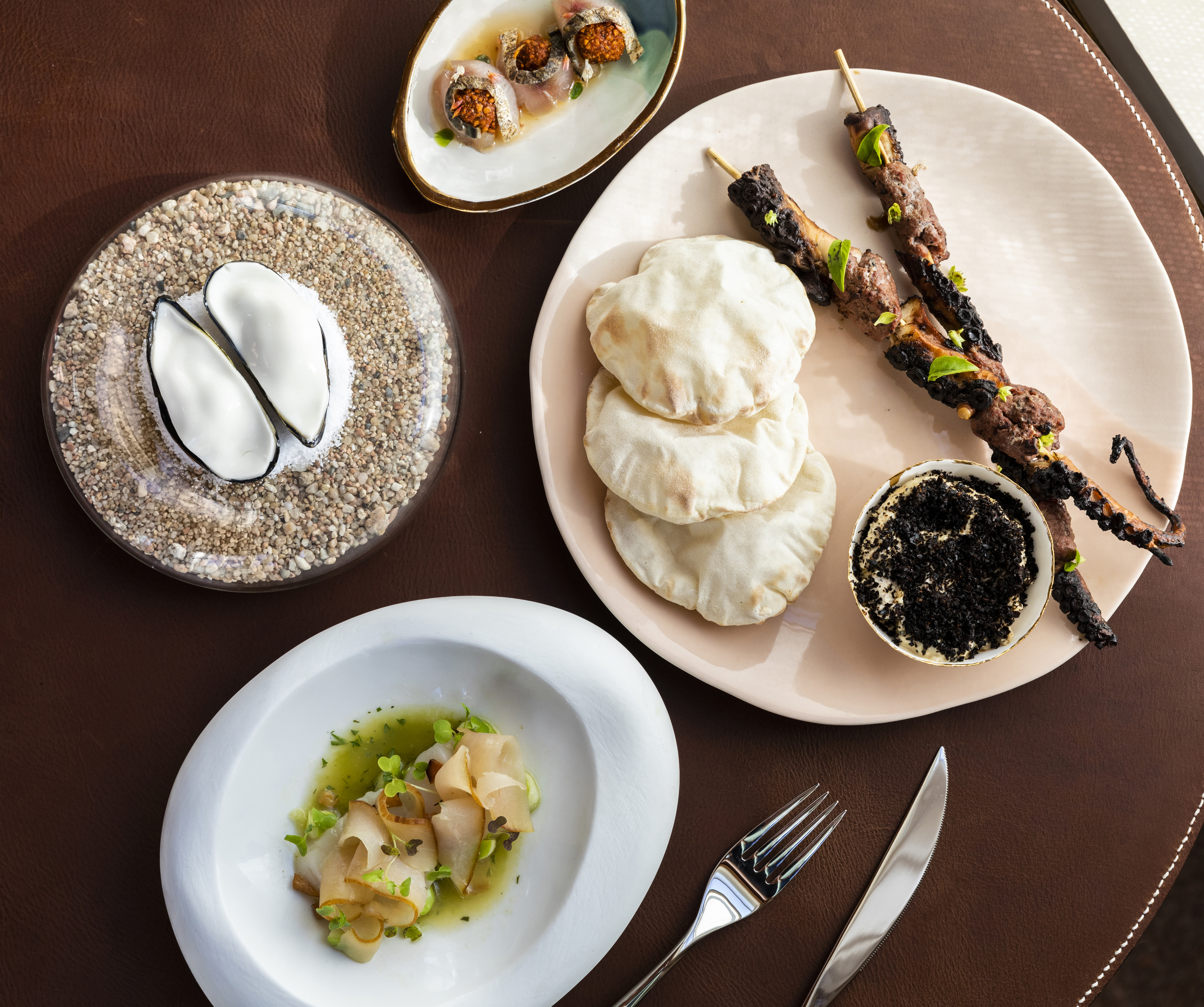 A top-view spread of Mediterranean dishes