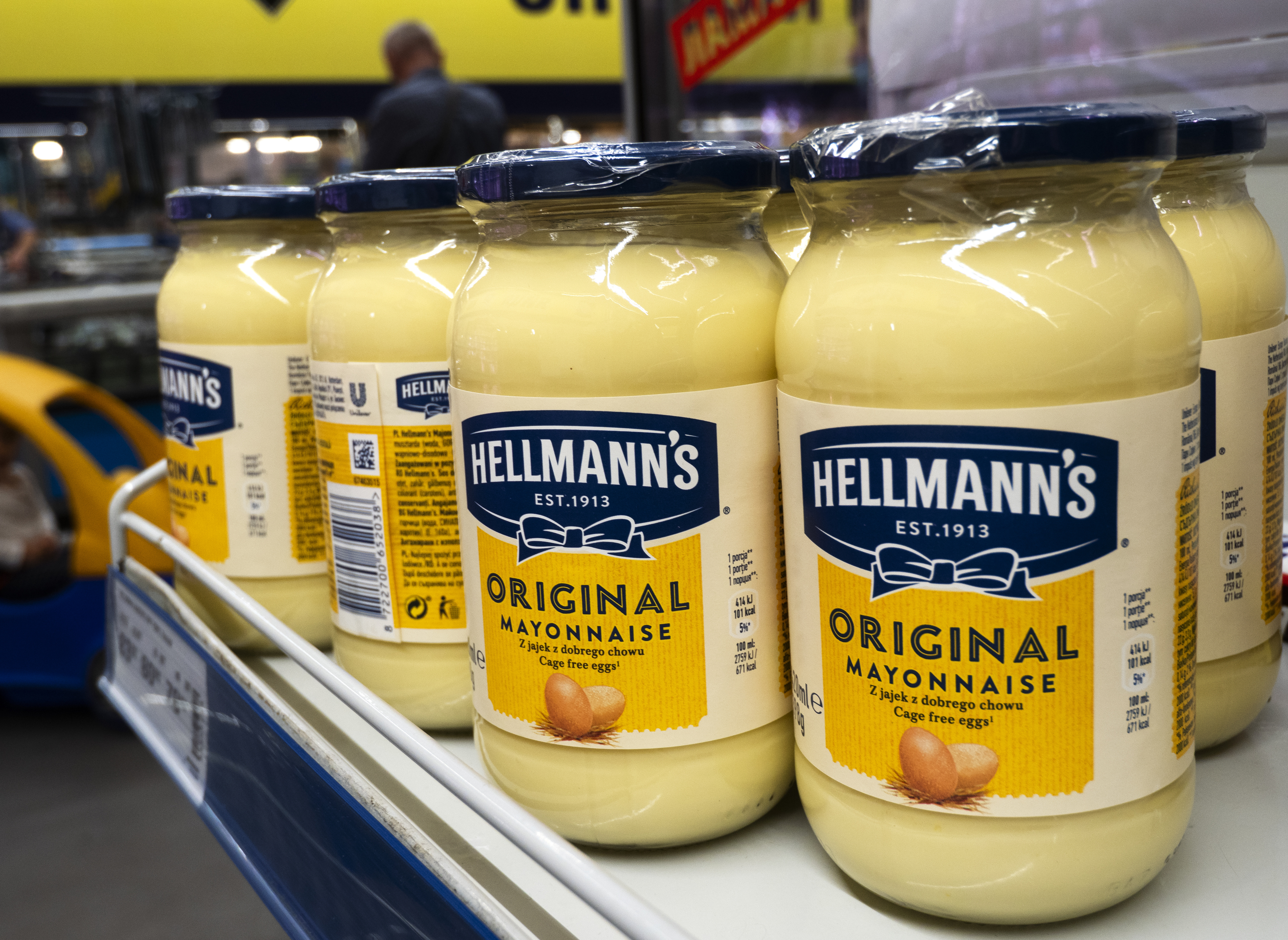 Hellmann's jars of mayonnaise seen on a shelf at a store...