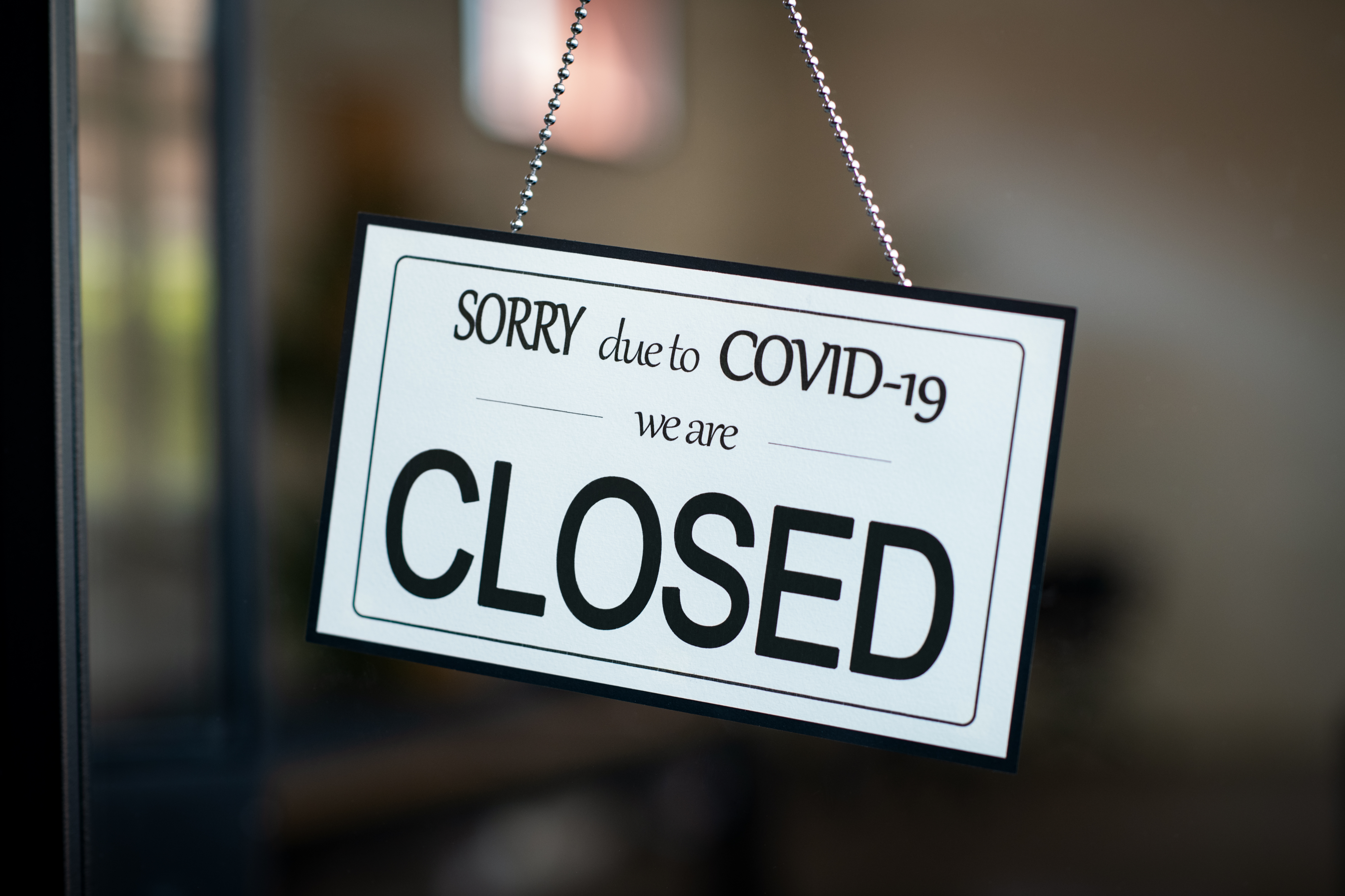"""A sign outside a restaurant that reads """"Sorry, due to COVID-19 we are closed"""""""