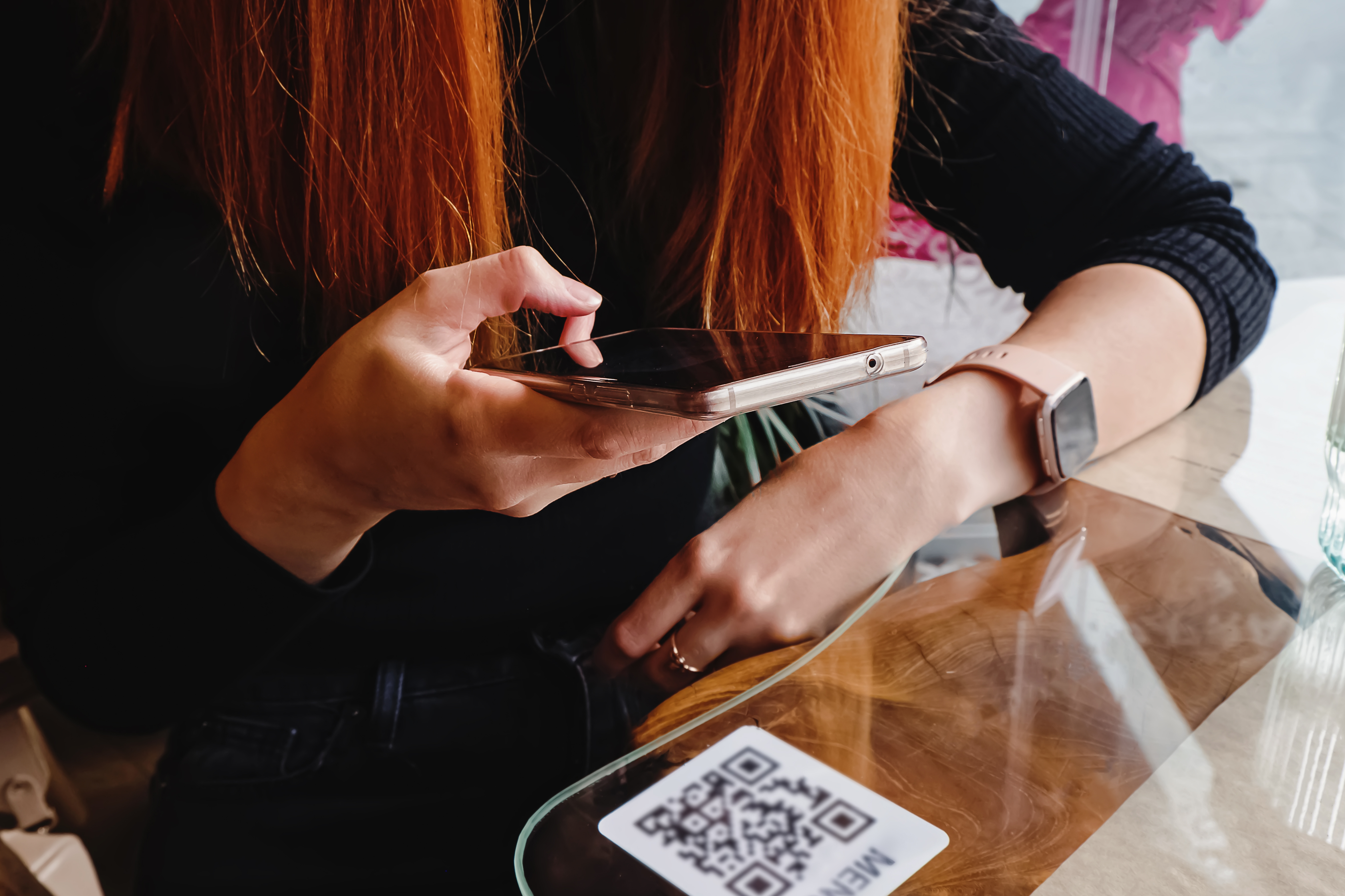 A person scanning a QR code with mobile phone