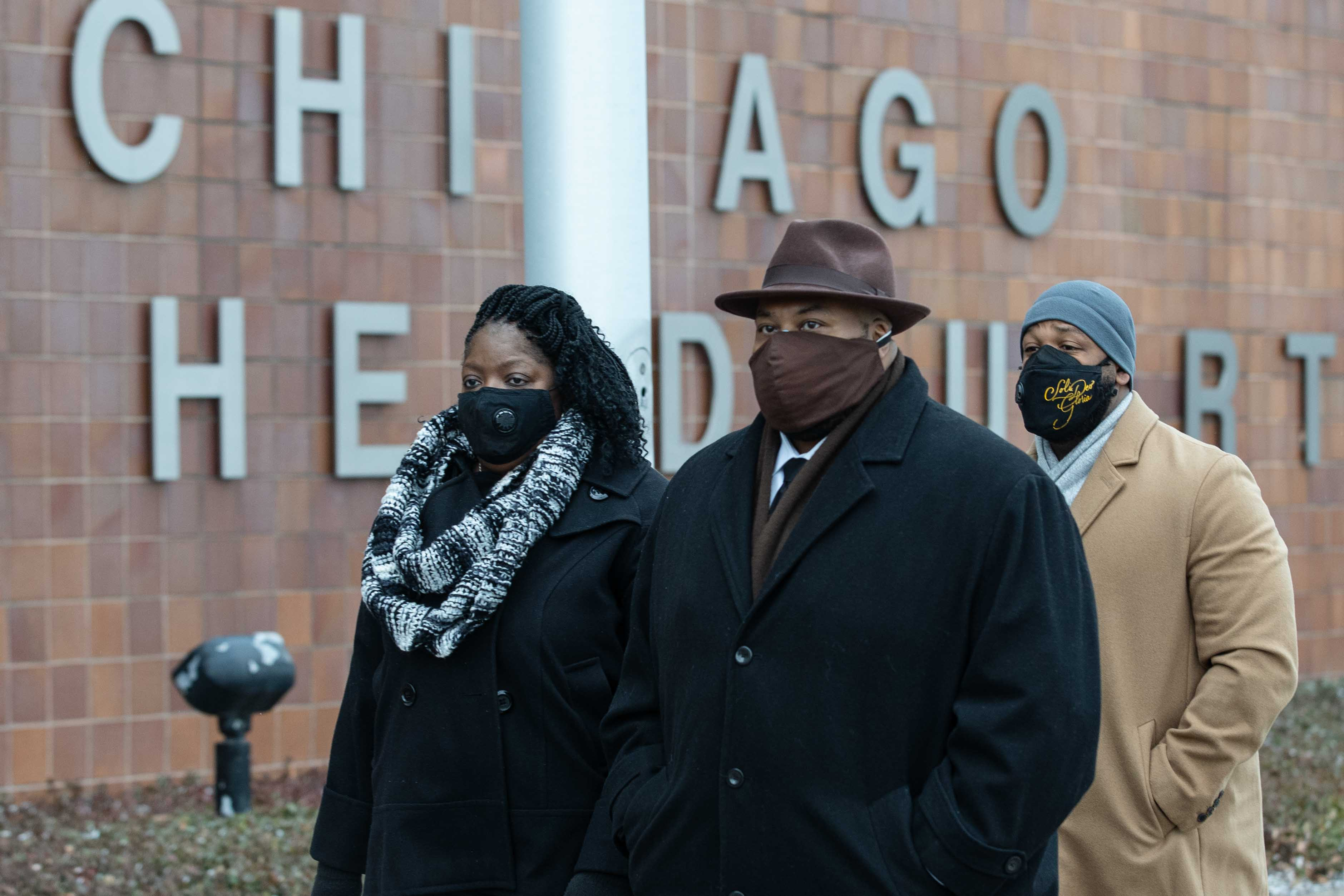 Anjanette Young, who was a victim of a botched raid by the Chicago Police Department in 2019, left, and her attorney Keenan Saulter, center, walks to a press conference outside the Chicago Police Department headquarters Dec. 16. Young met with Mayor Lori Lightfoot on Thursday.